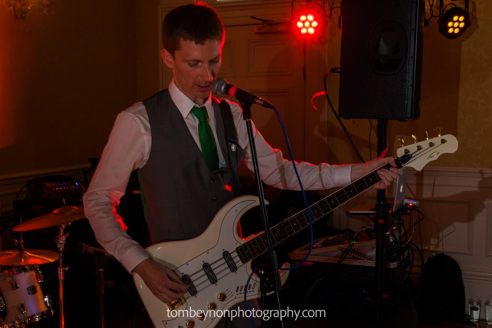Groom plays bass