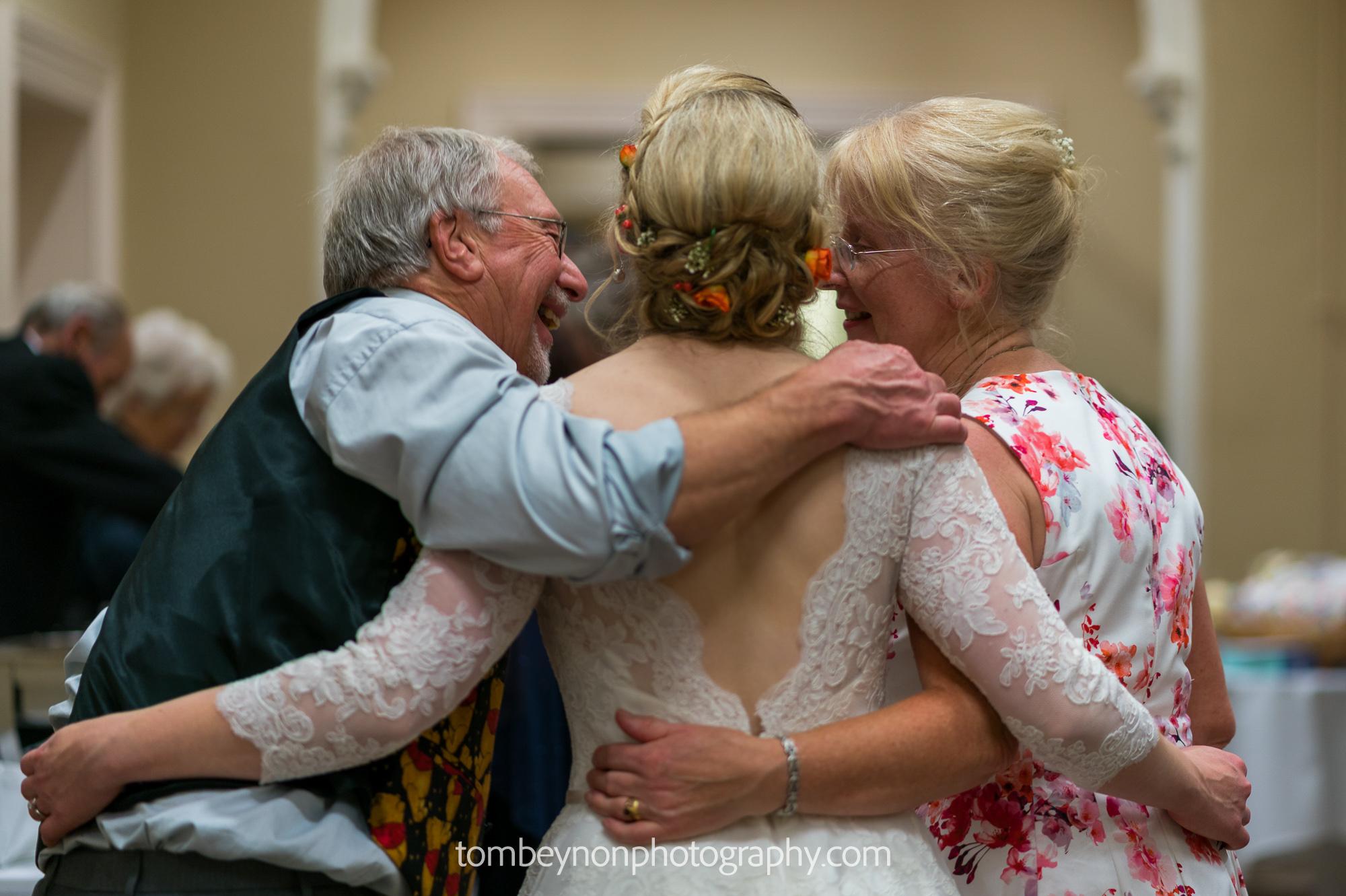 Bride enjoys time with parents