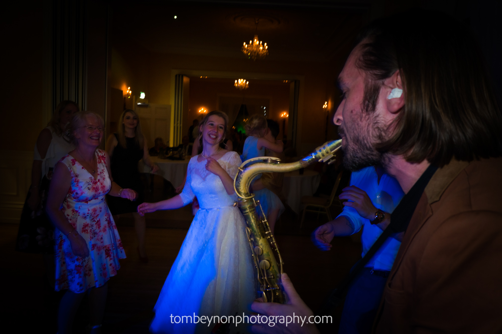 Sax on the dance floor with bride