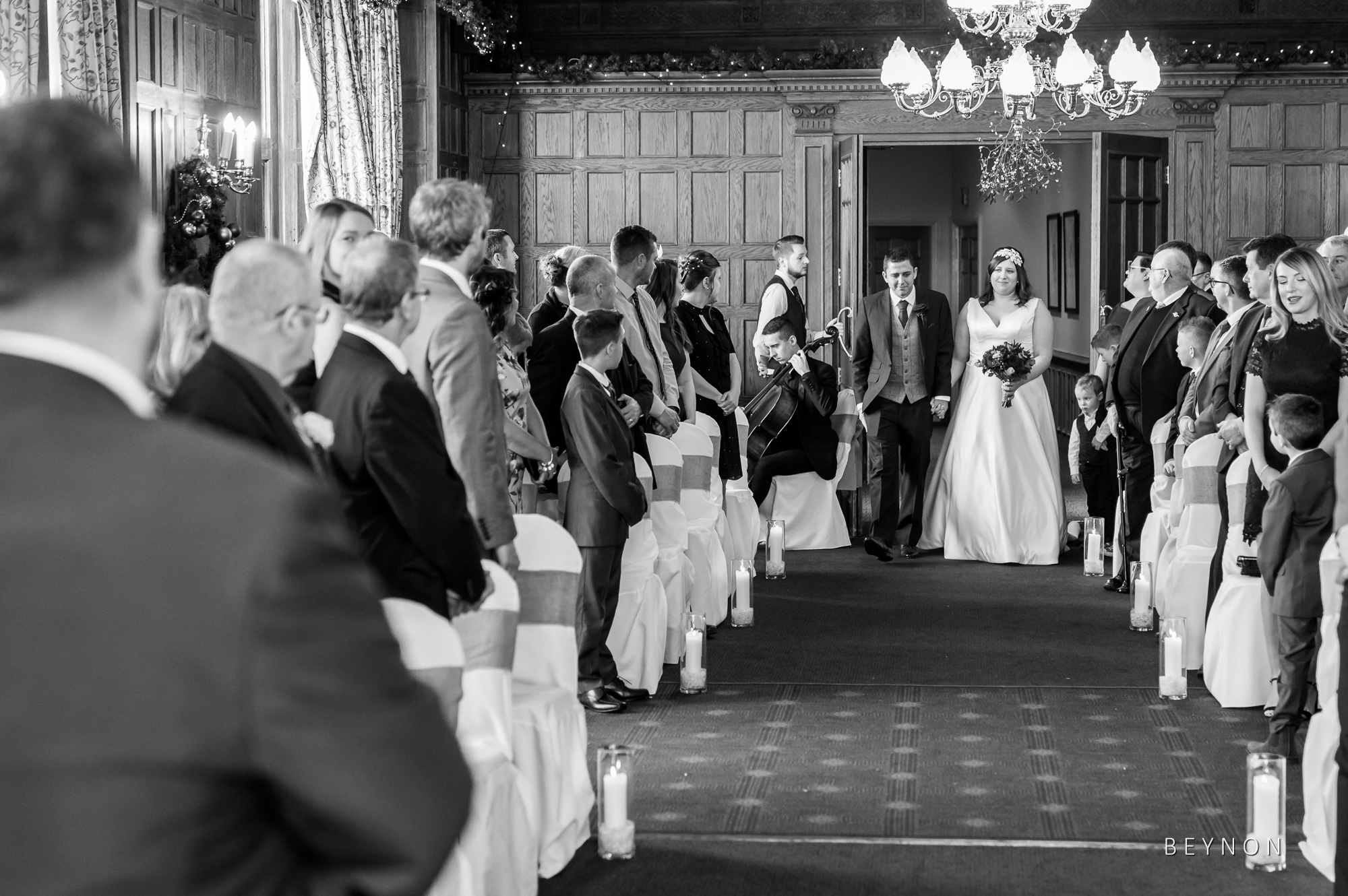 The Bride enters the room as the Groom watches