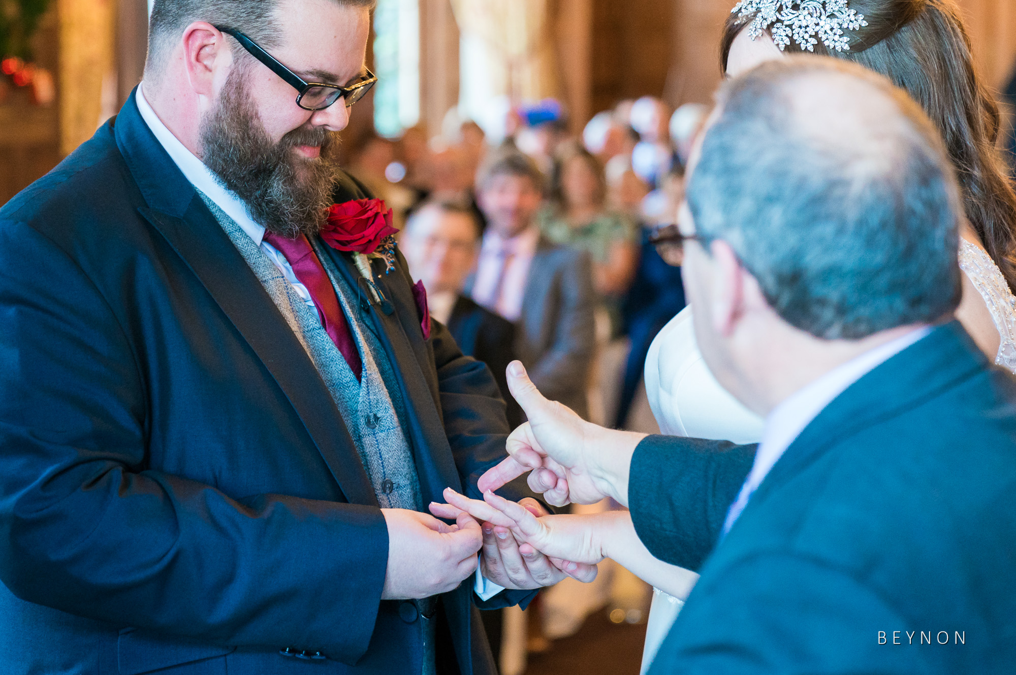 The celebrant points to the correct finger for the rings