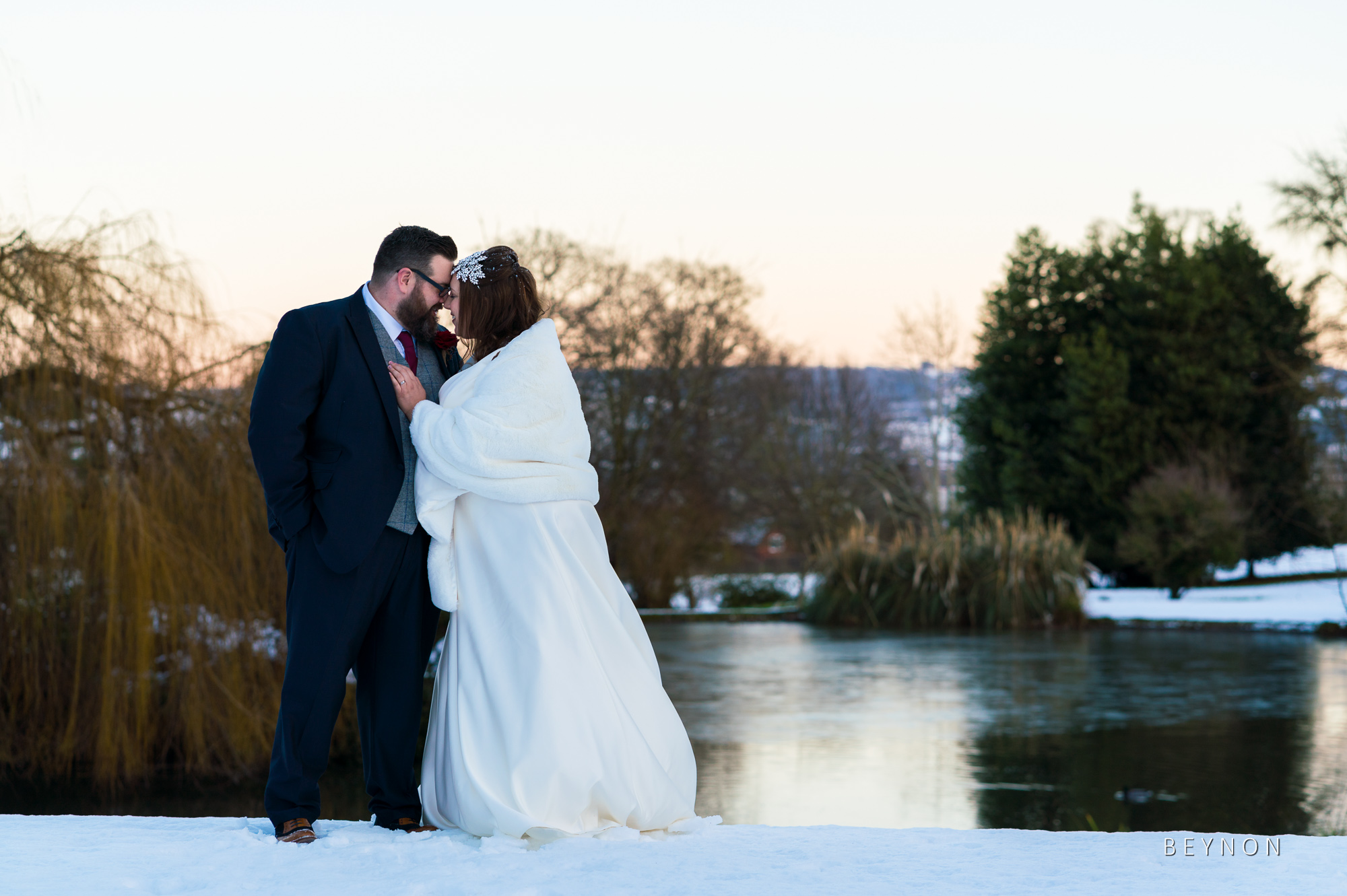 The Bride and Groom by the lake at Dumbleton Hall