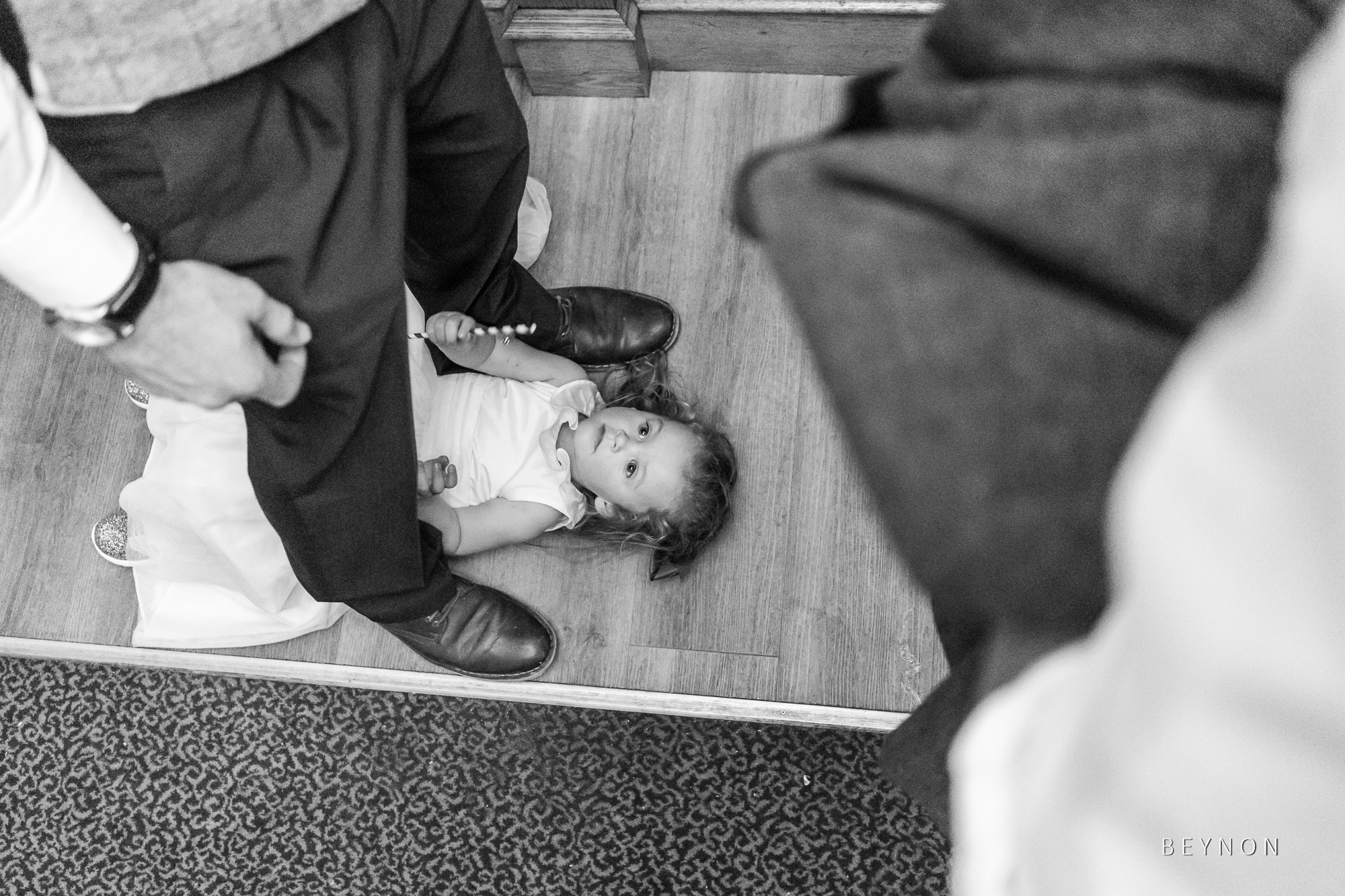 Small child lying on the floor