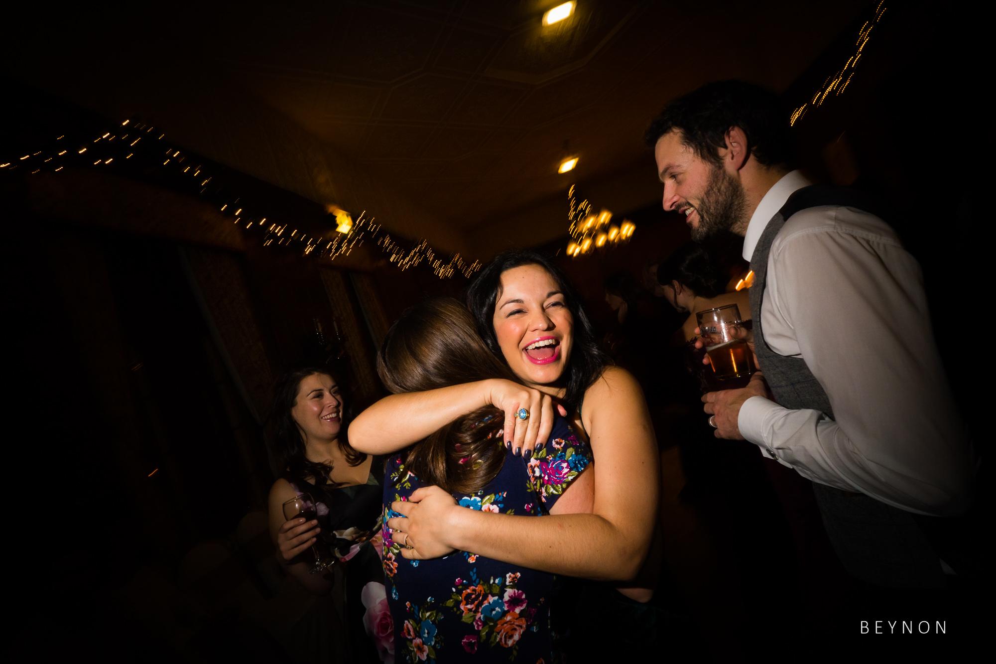 Guests hug on the dance floor