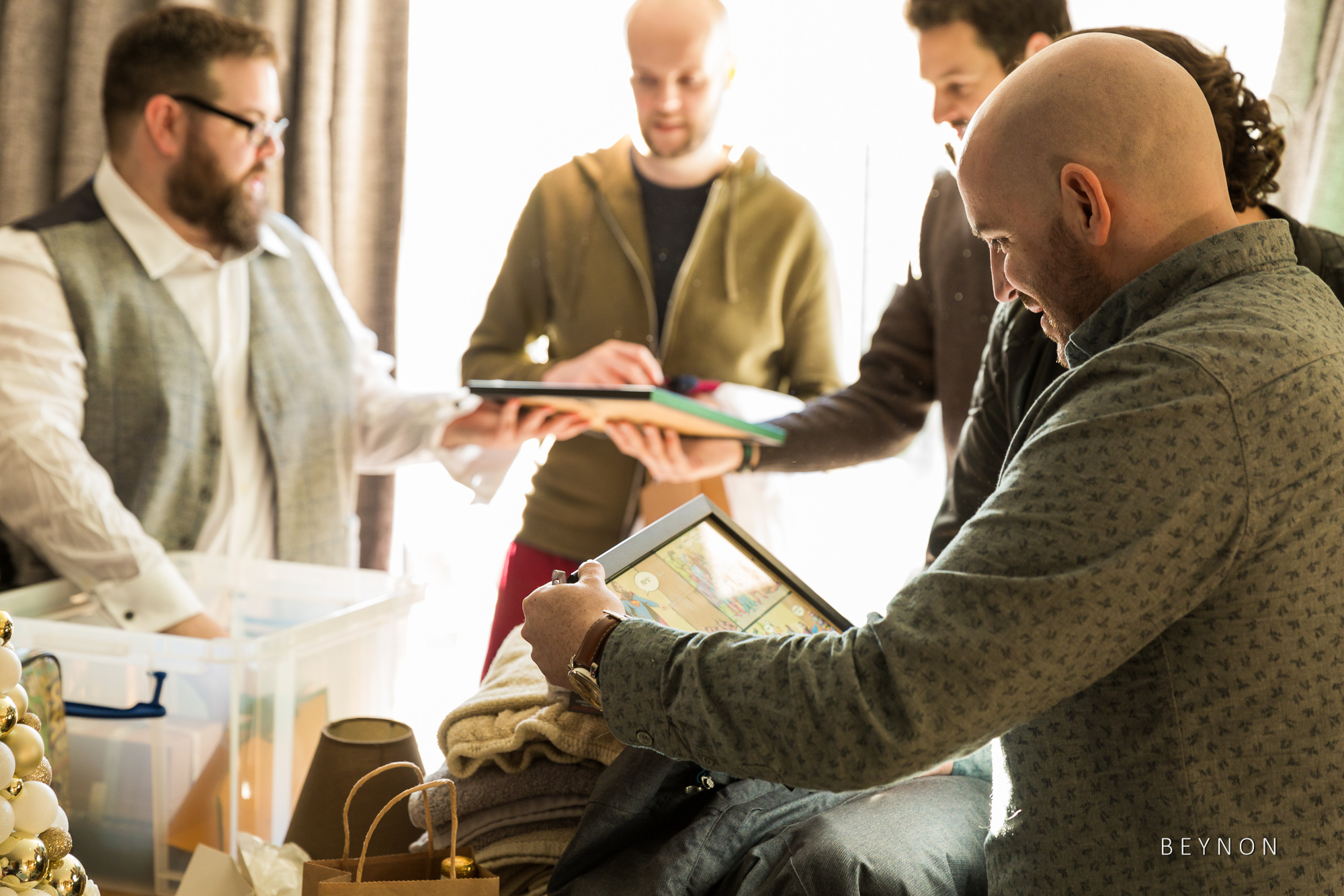 The Groom hands out presents to his groomsmen