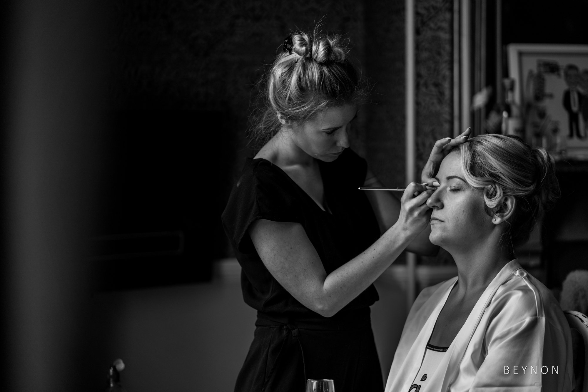 The bride has make-up applied