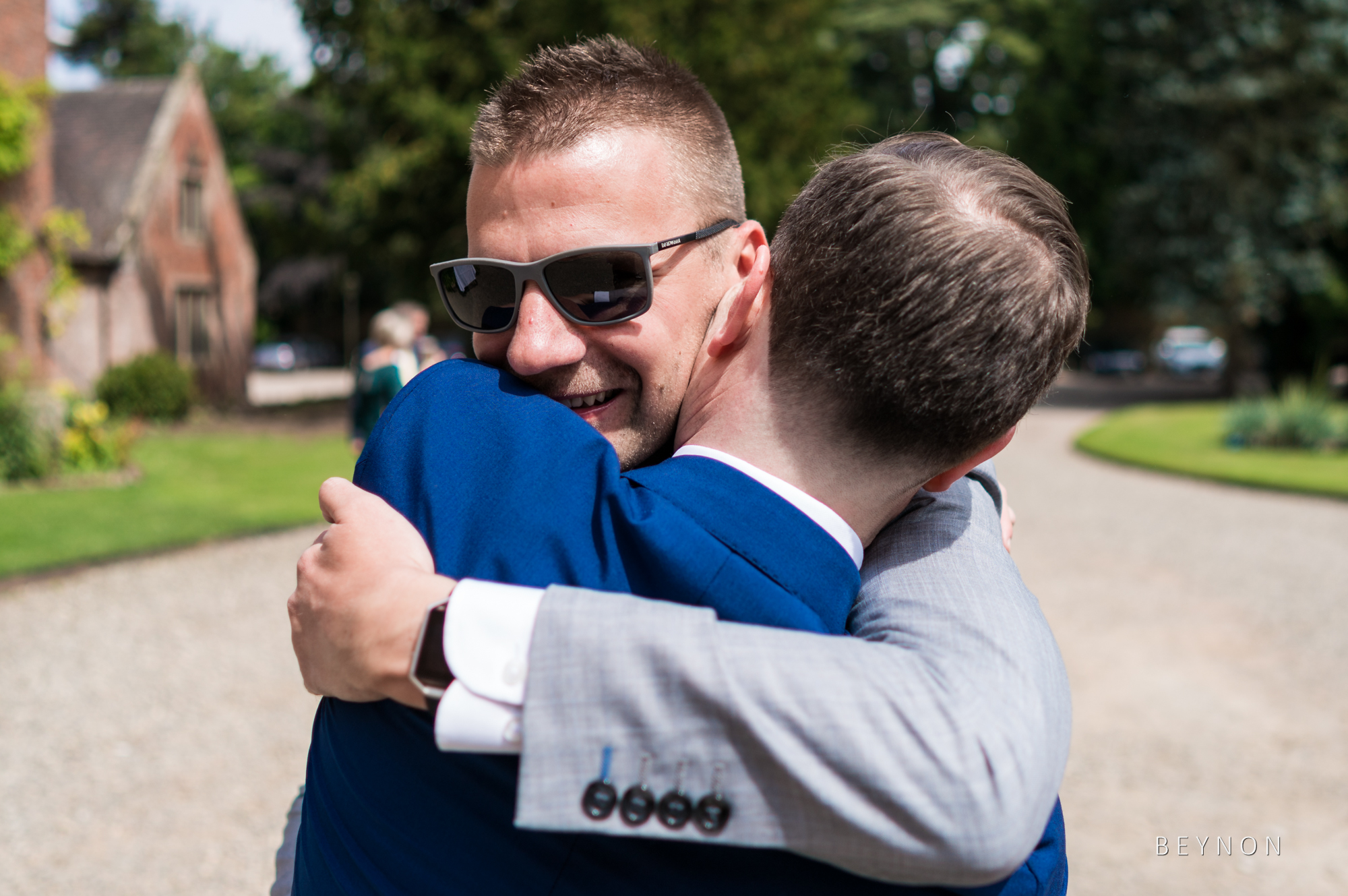 Guests hug as they arrive