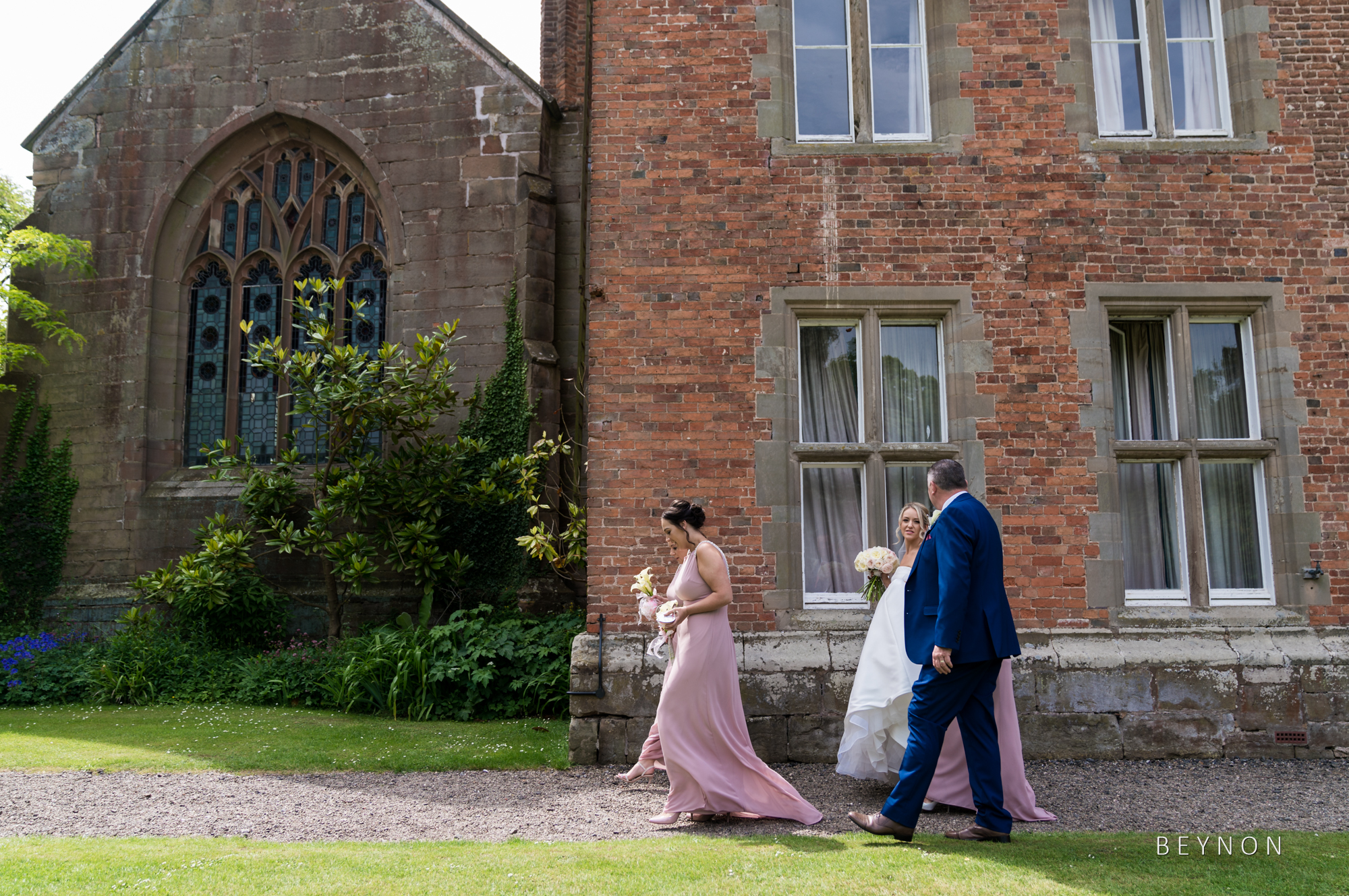 The bride walks to the chapel for the ceremony