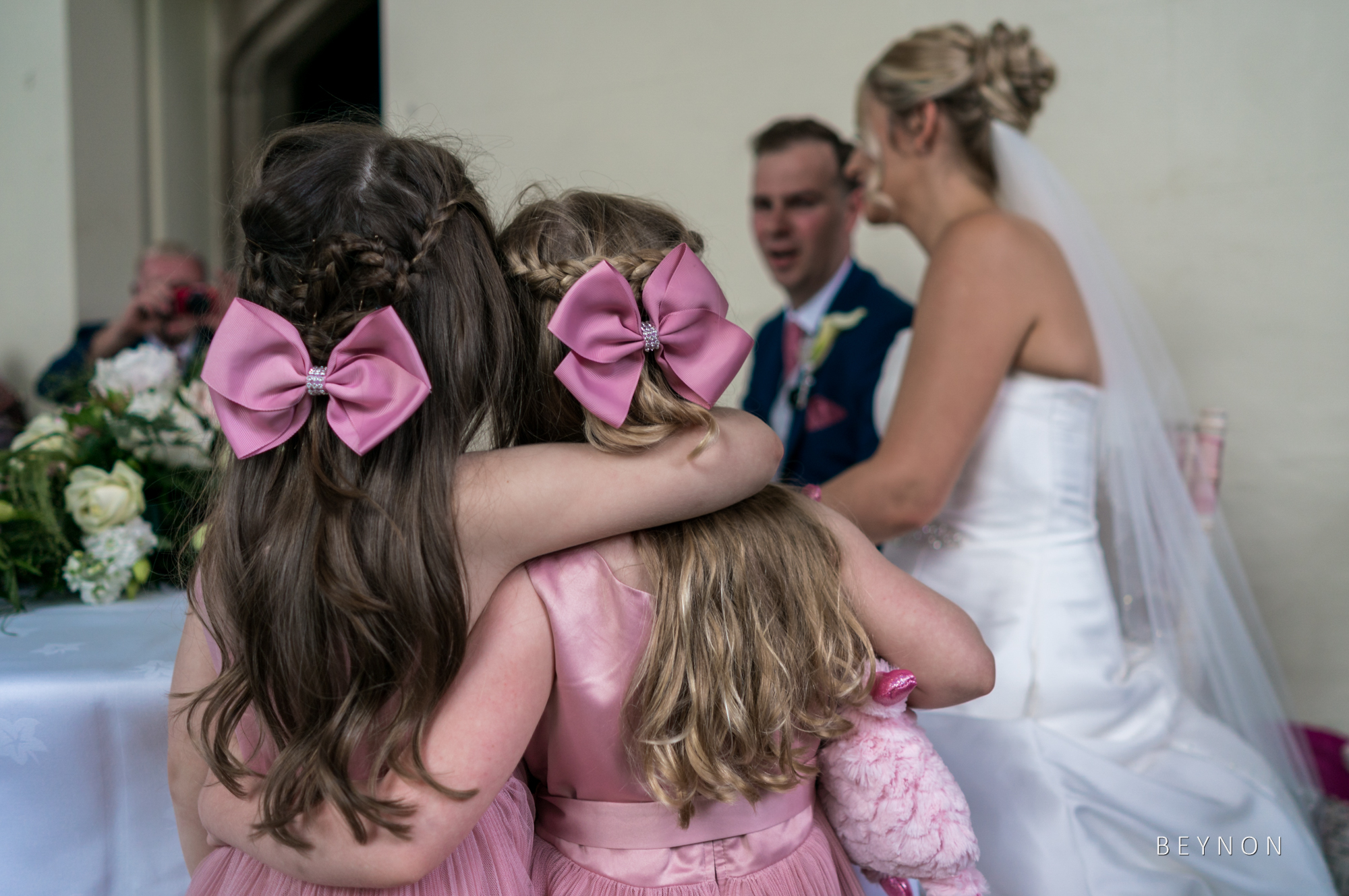 The flower girls watch the newlyweds sign the register
