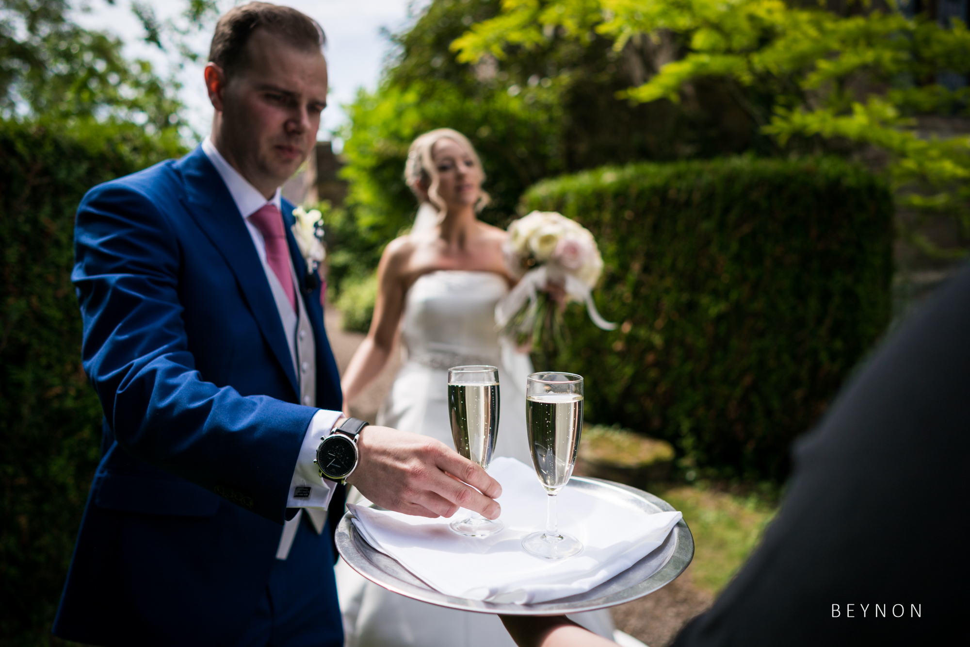 The bride and groom pick up their post-ceremony champagne