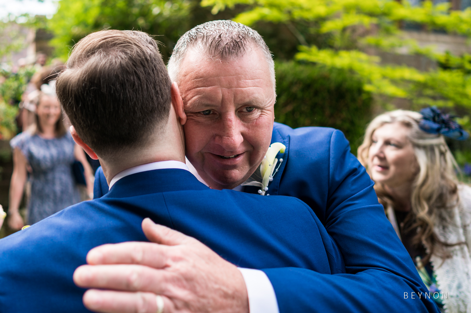 The father of the bride hugs the groom
