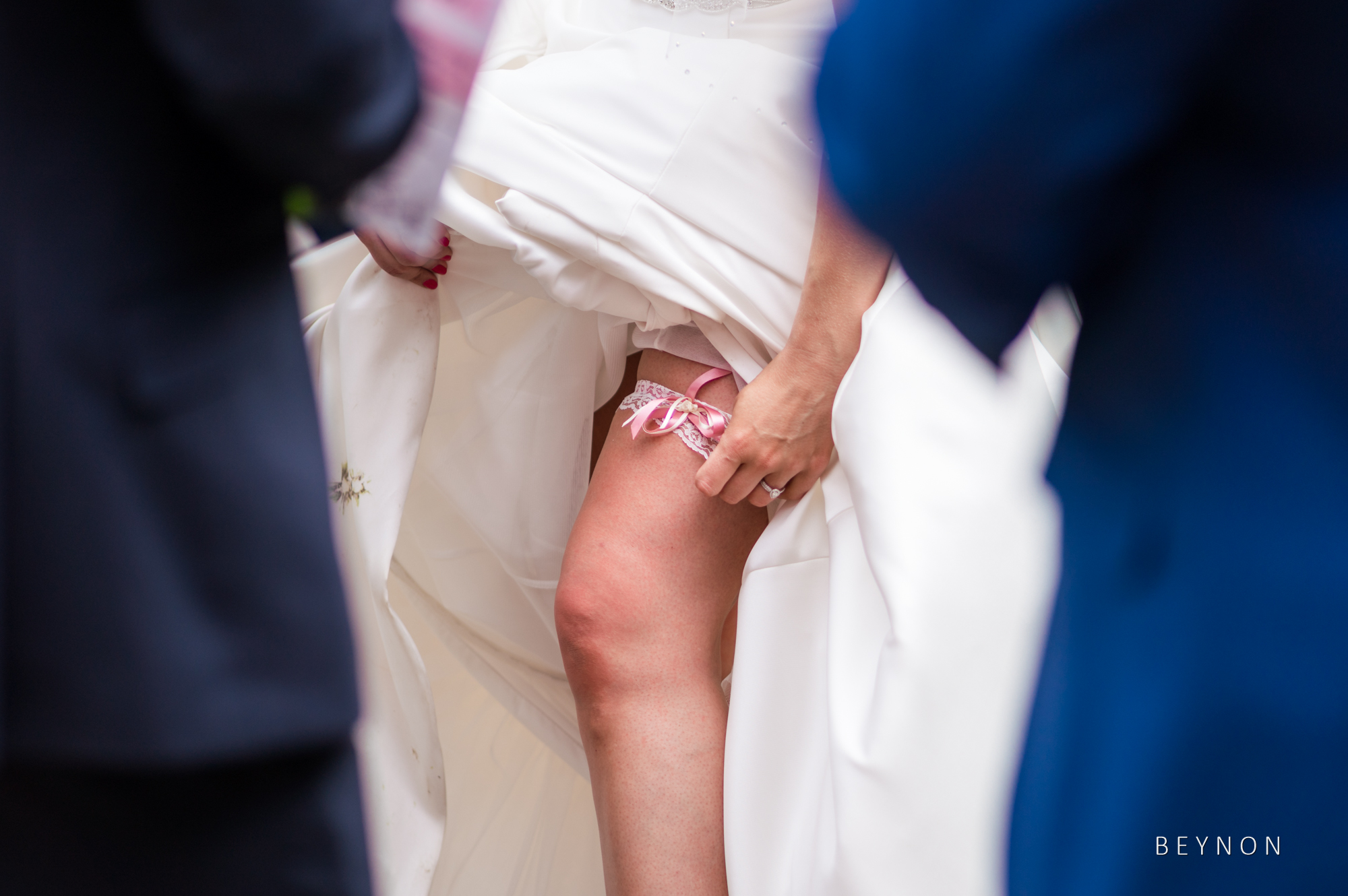 The bride show off her garter