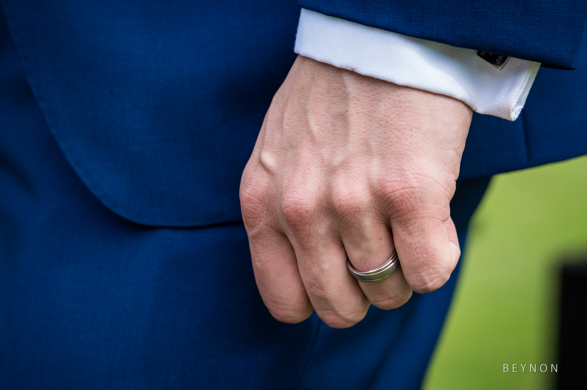 Close up shot of the groom's wedding ring