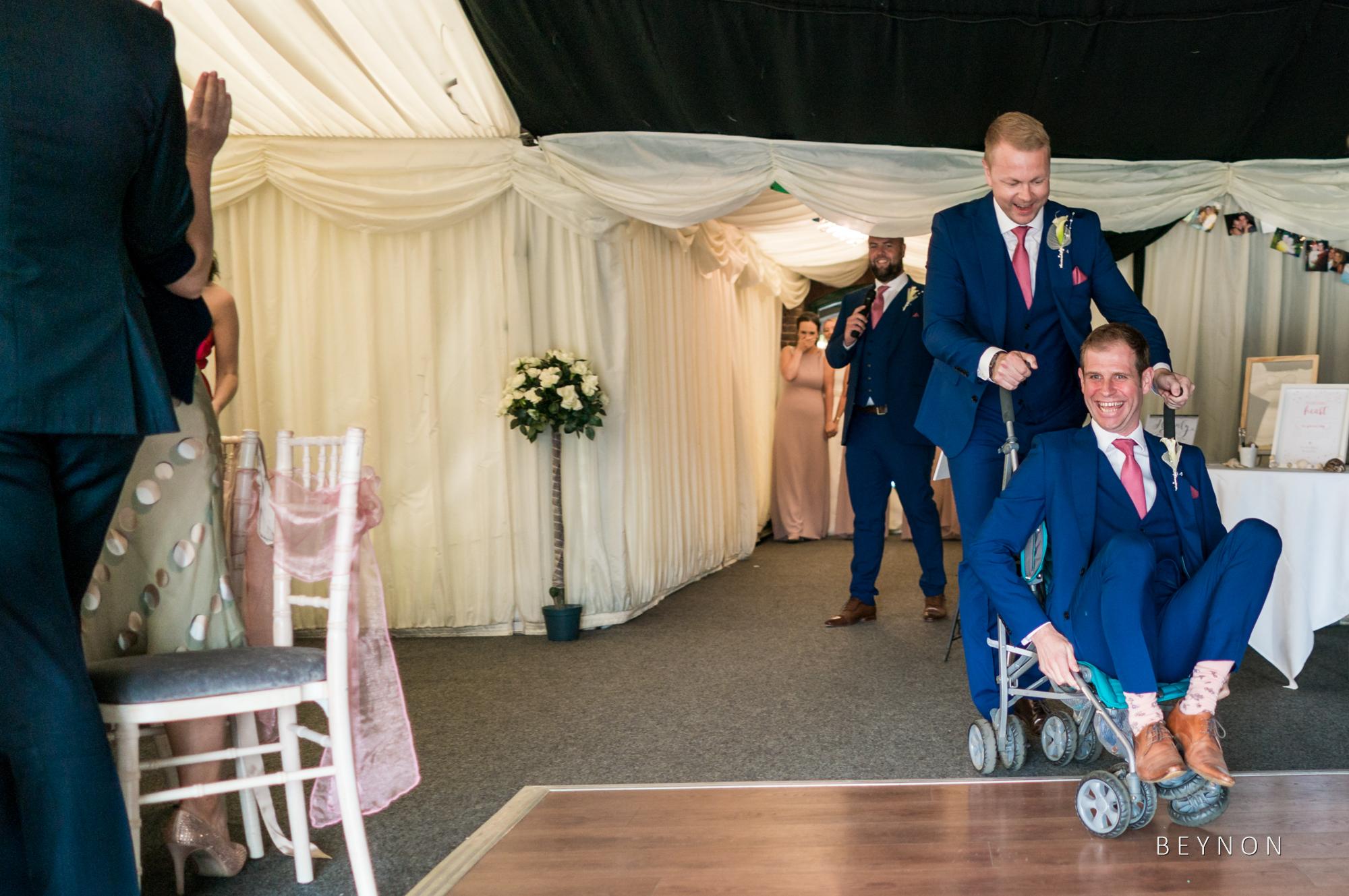 The groomsmen enter in a pushchair