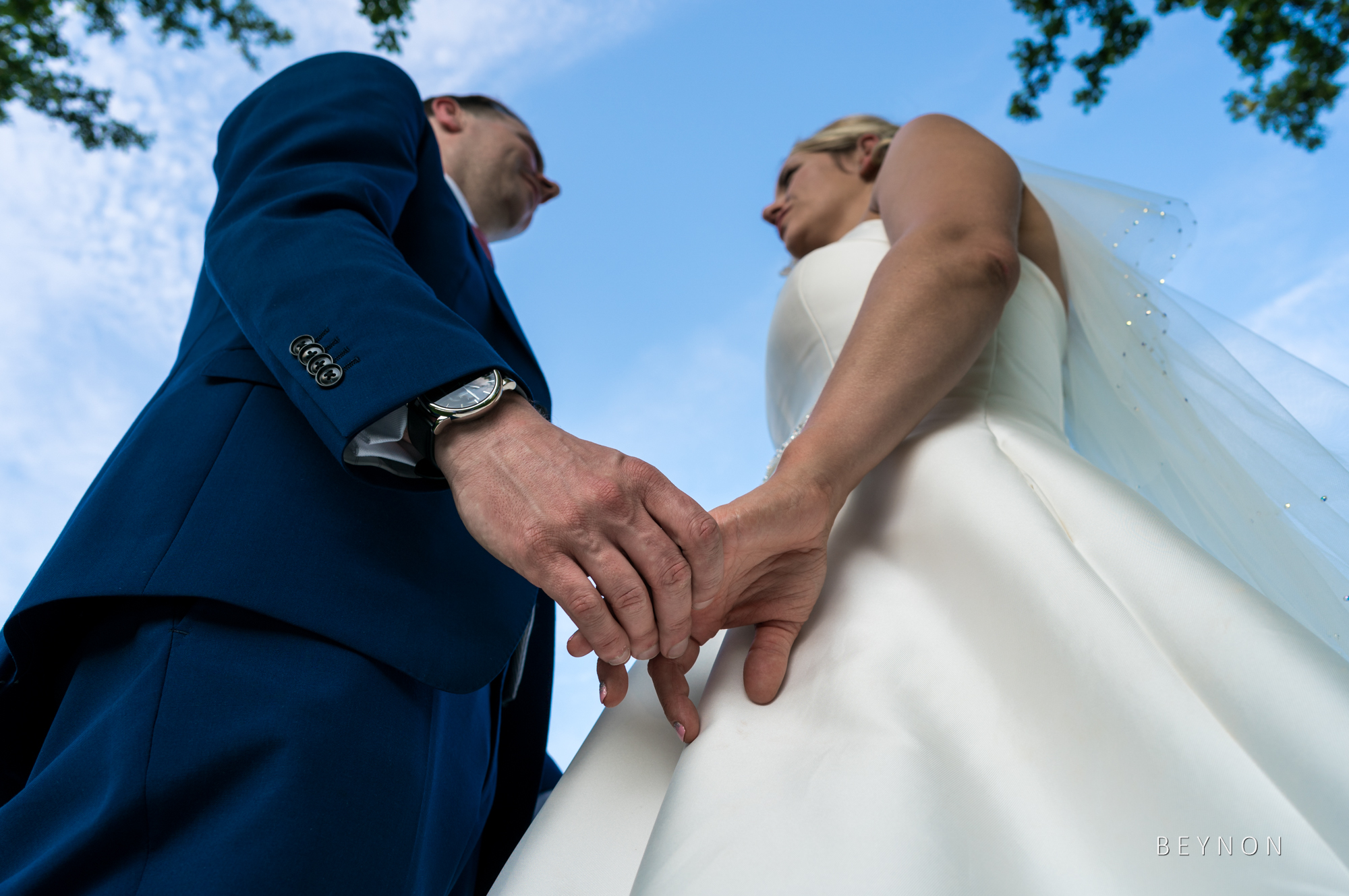 The newlyweds hold hands