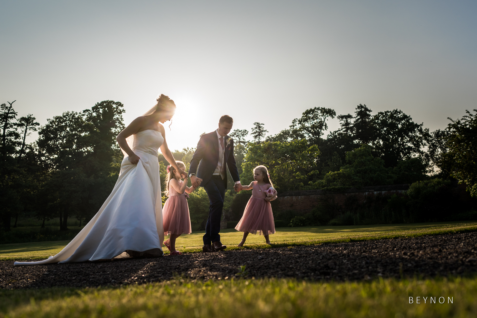 The bride and groom walk with the flower girls