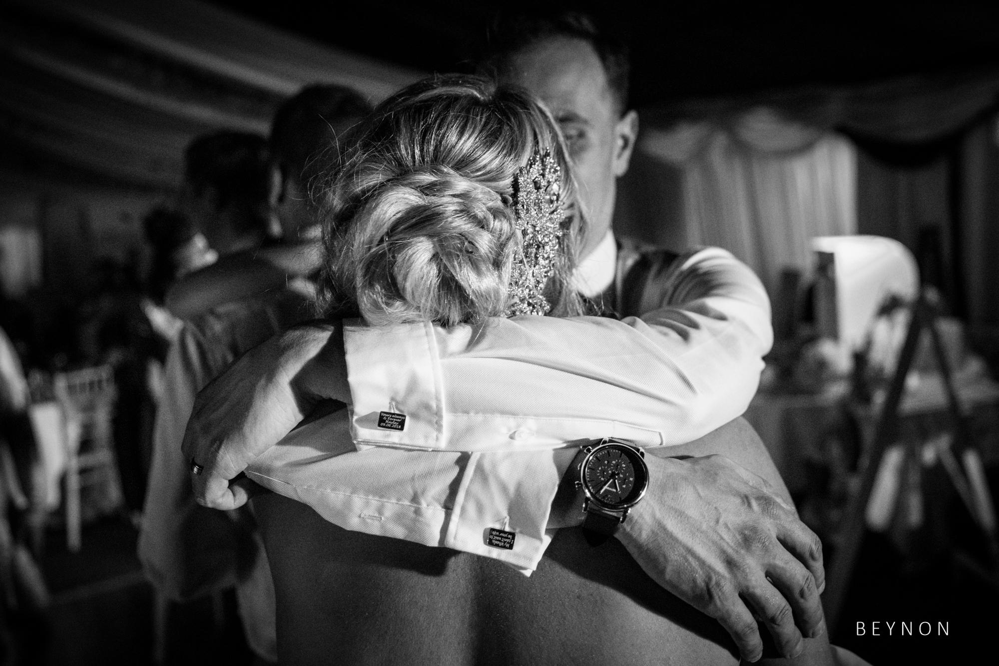 The bride and groom hug