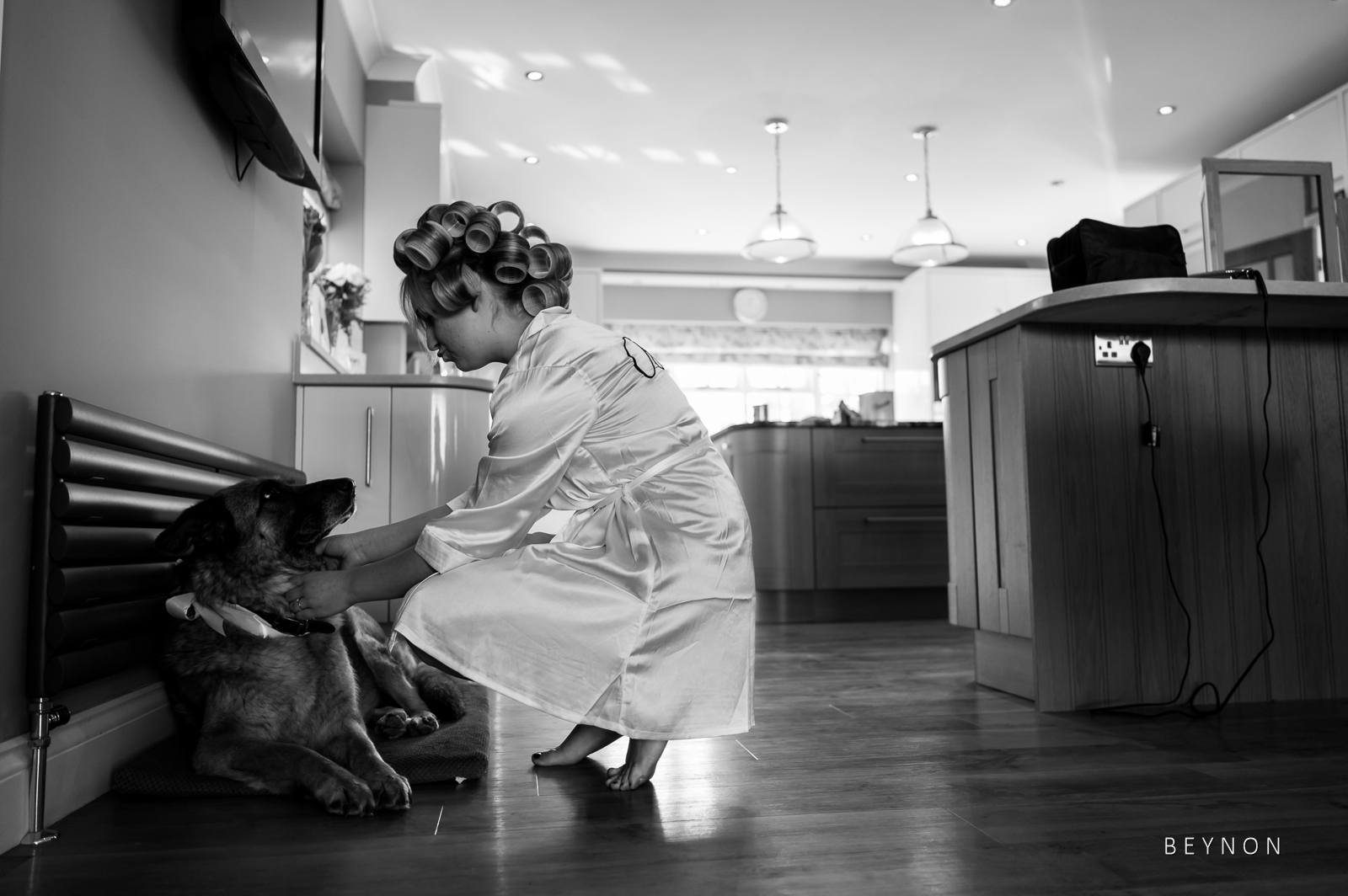 The bride stroking her pet dog