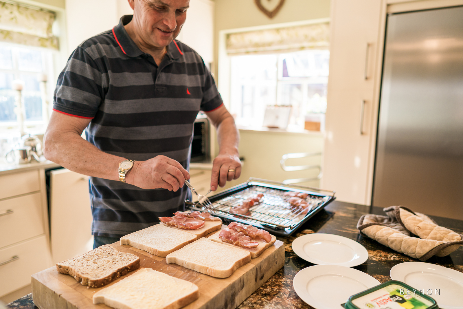 Dad making bacon sandwiches
