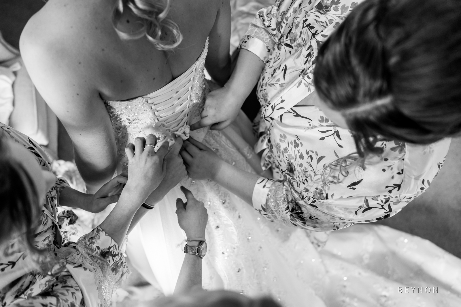 Back of the bride's dress being done up