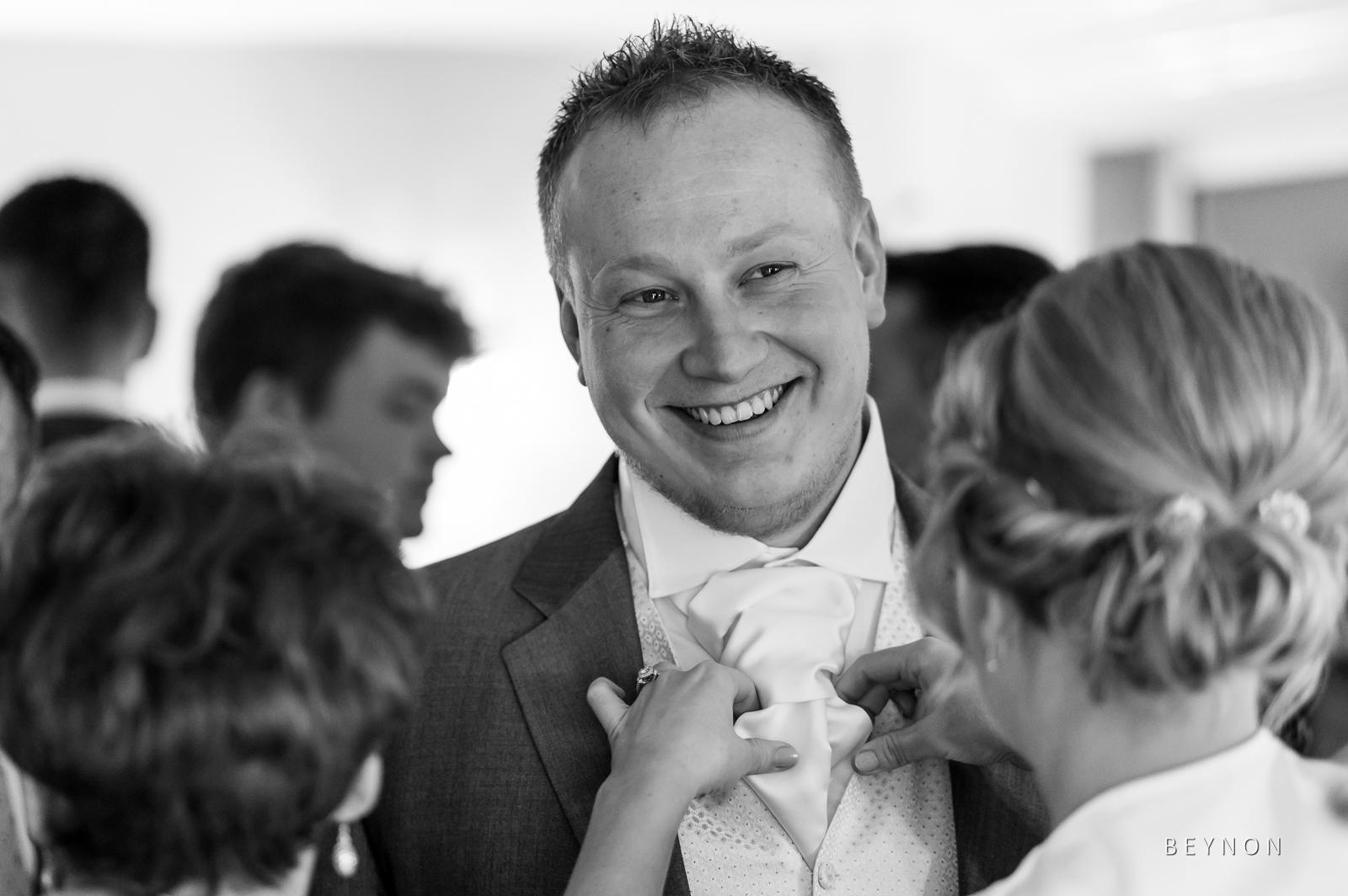 The groom has his cravat tied