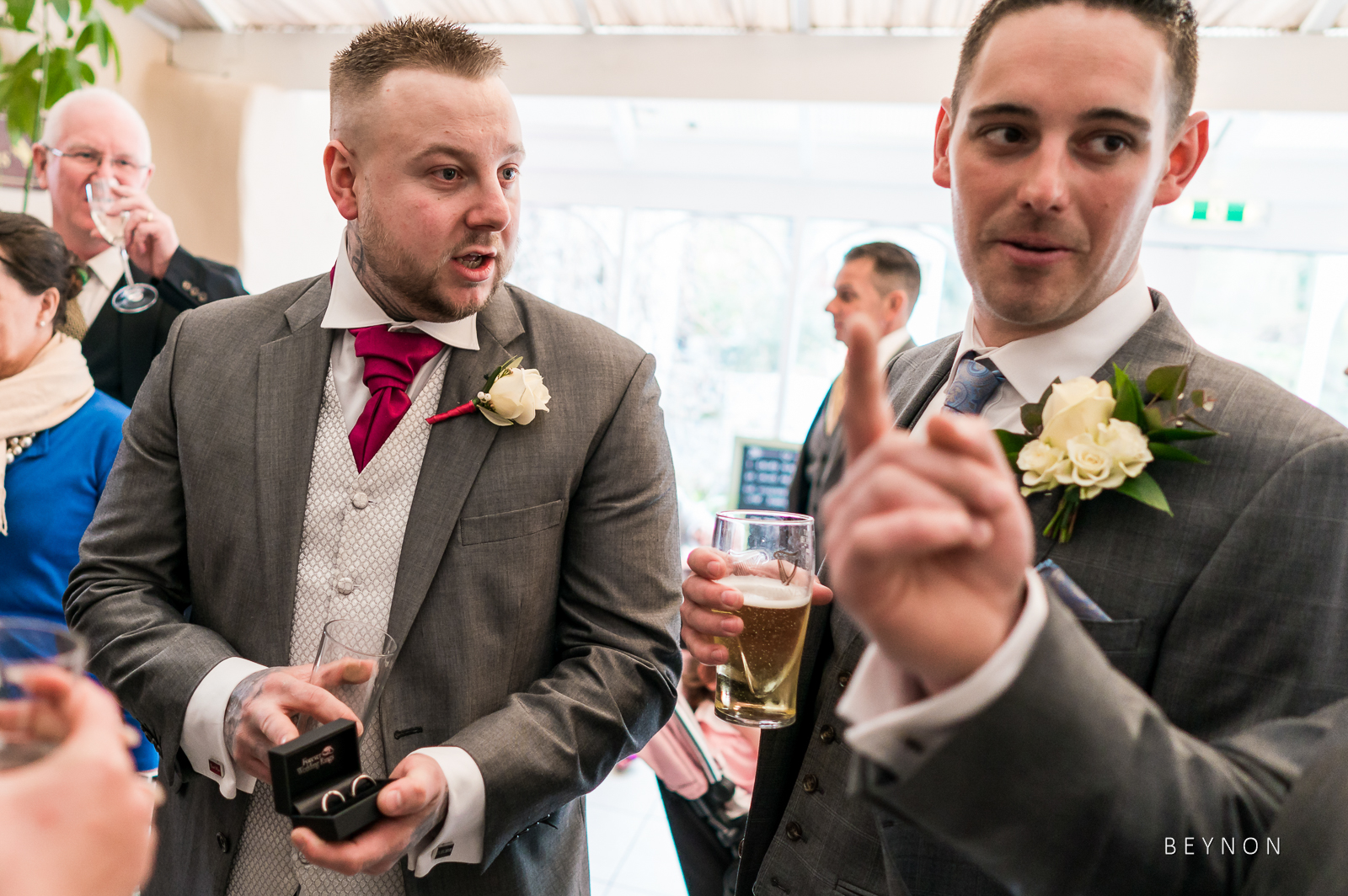 Best Man shows off the wedding rings