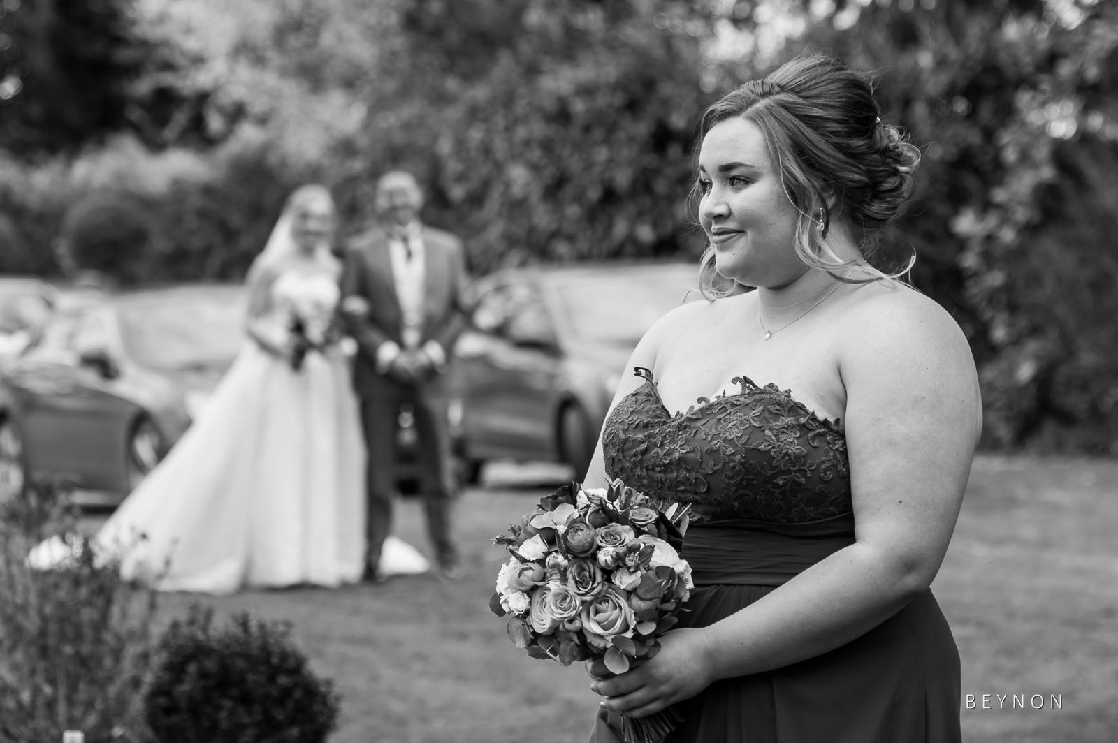 Bridesmaid walks down the aisle