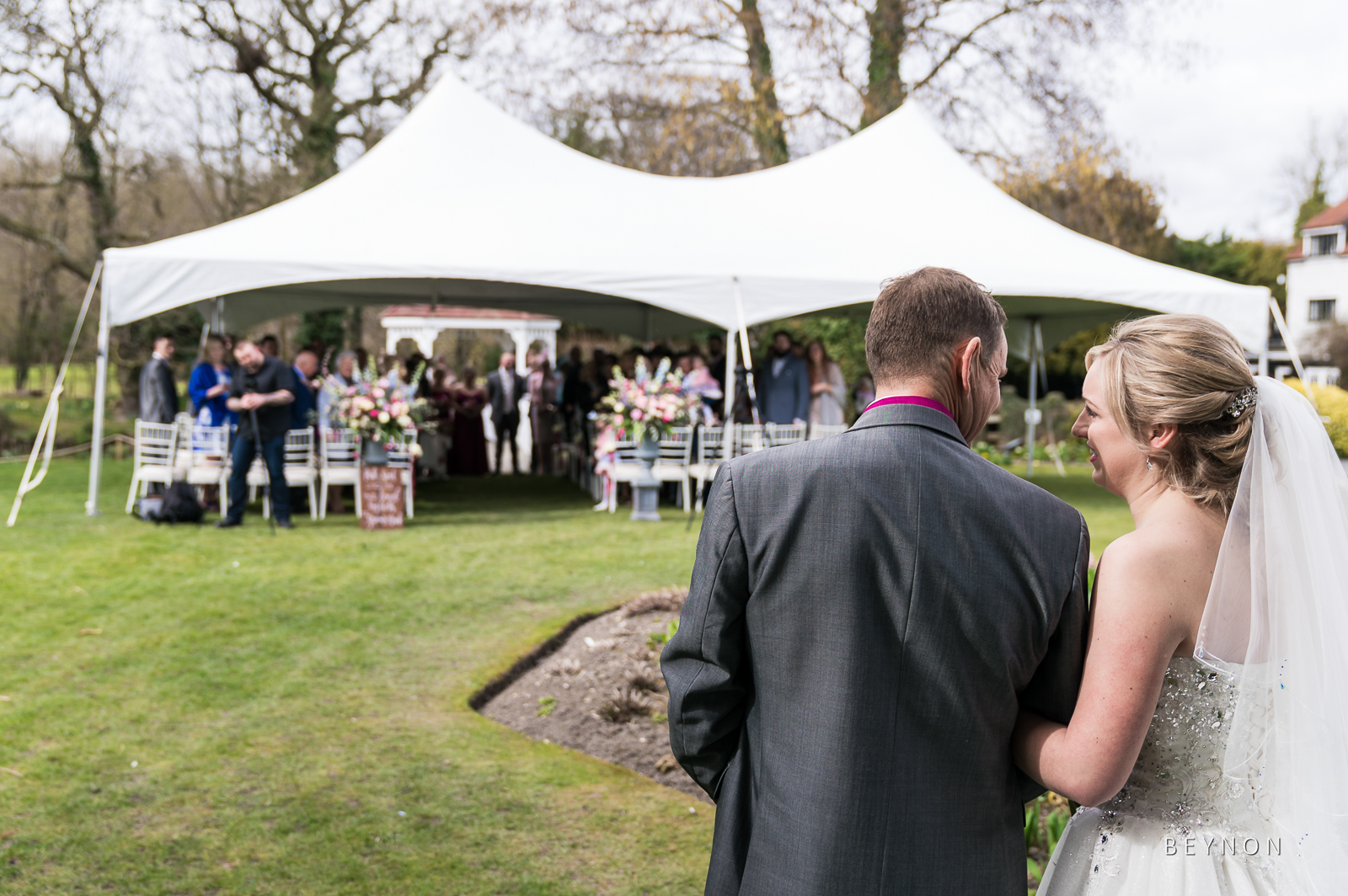Dad and Bride look at each other before he gives her away