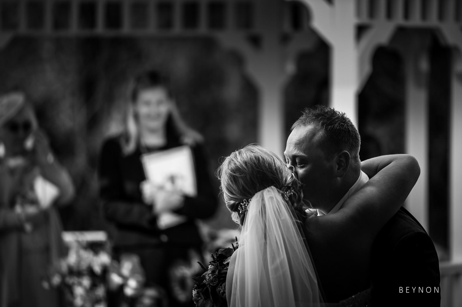 The Groom kisses his Bride