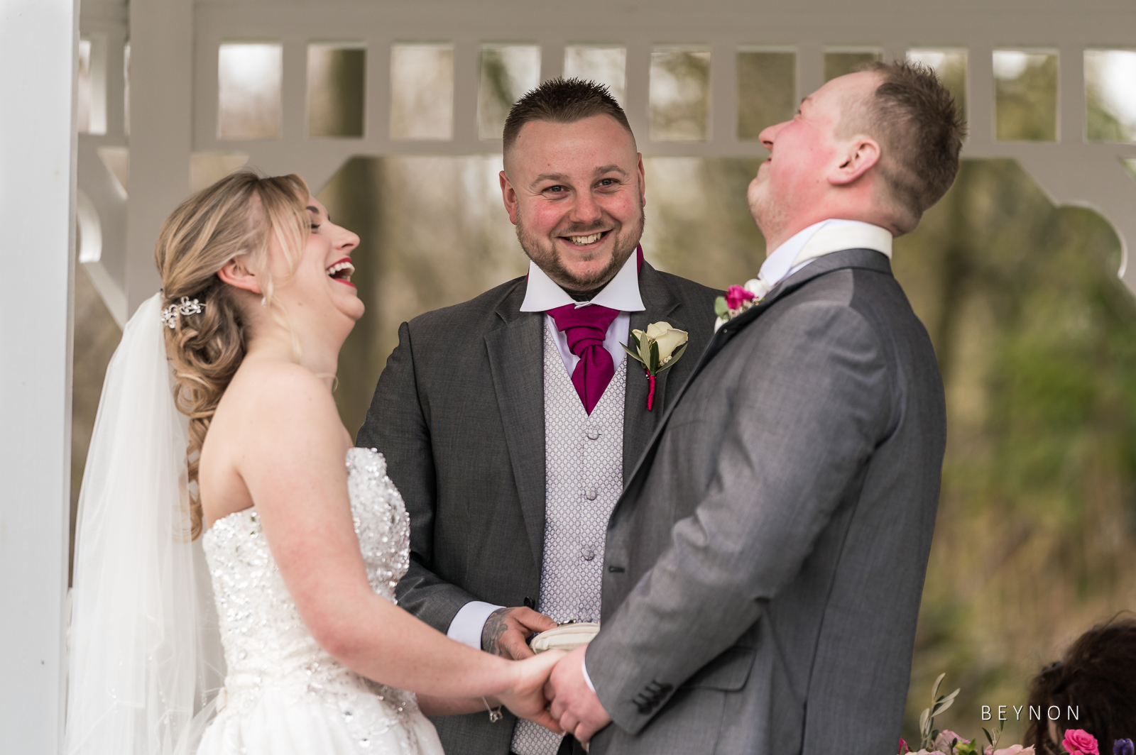 The happy couple laugh during their ceremony