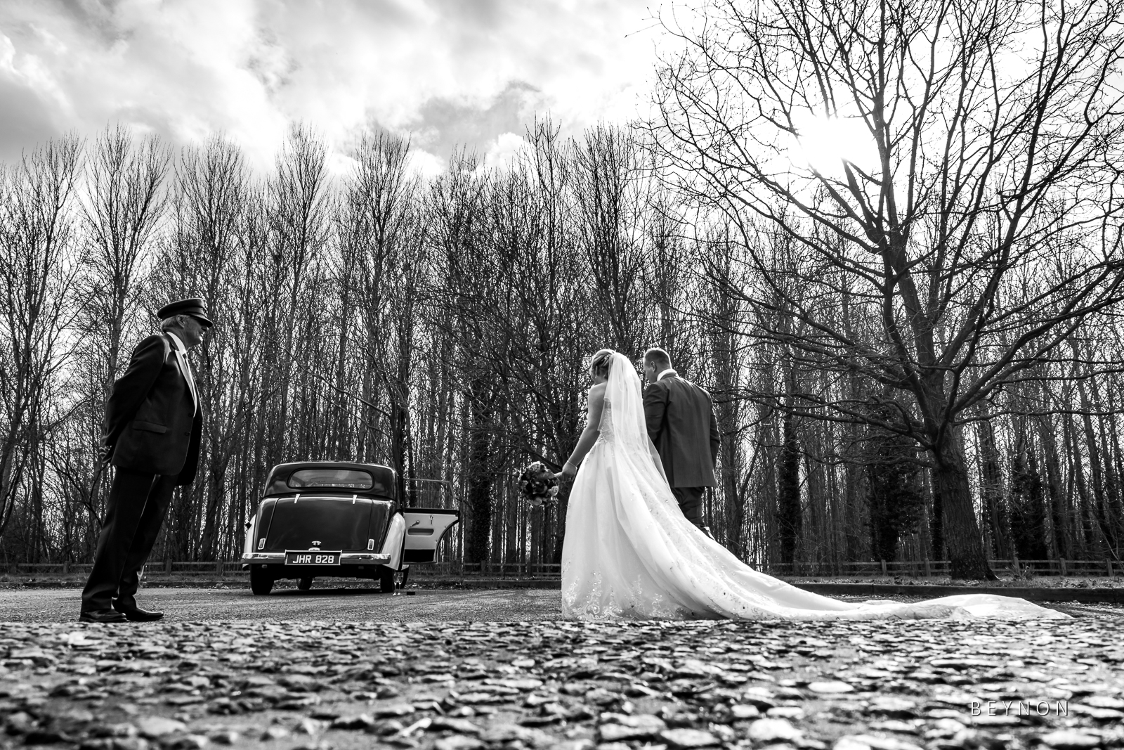 The Bride and Groom walk back to their car