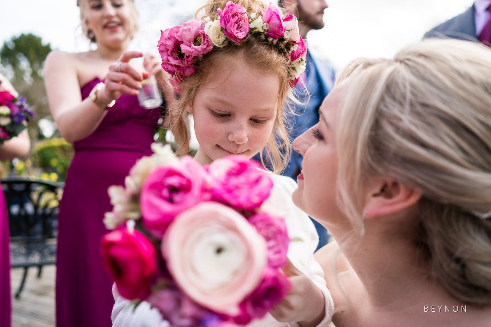 Bride talks to flower girl