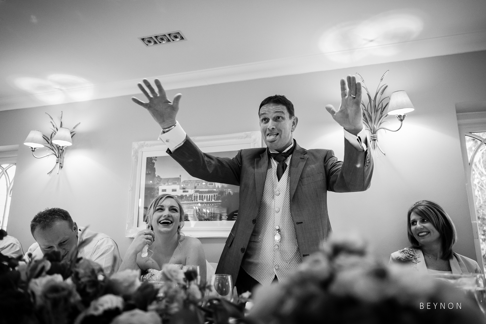 Father of the bride gestures during speech