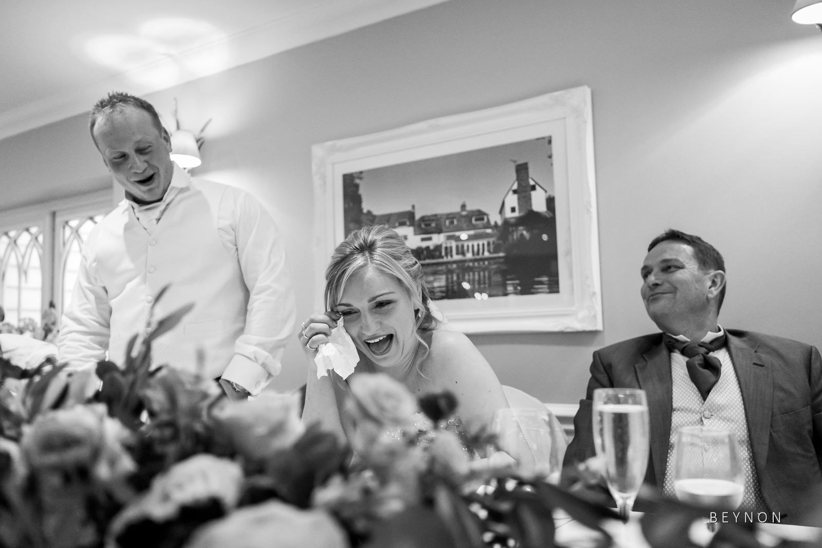 Bride wipes a tear from eye during her husband's speech