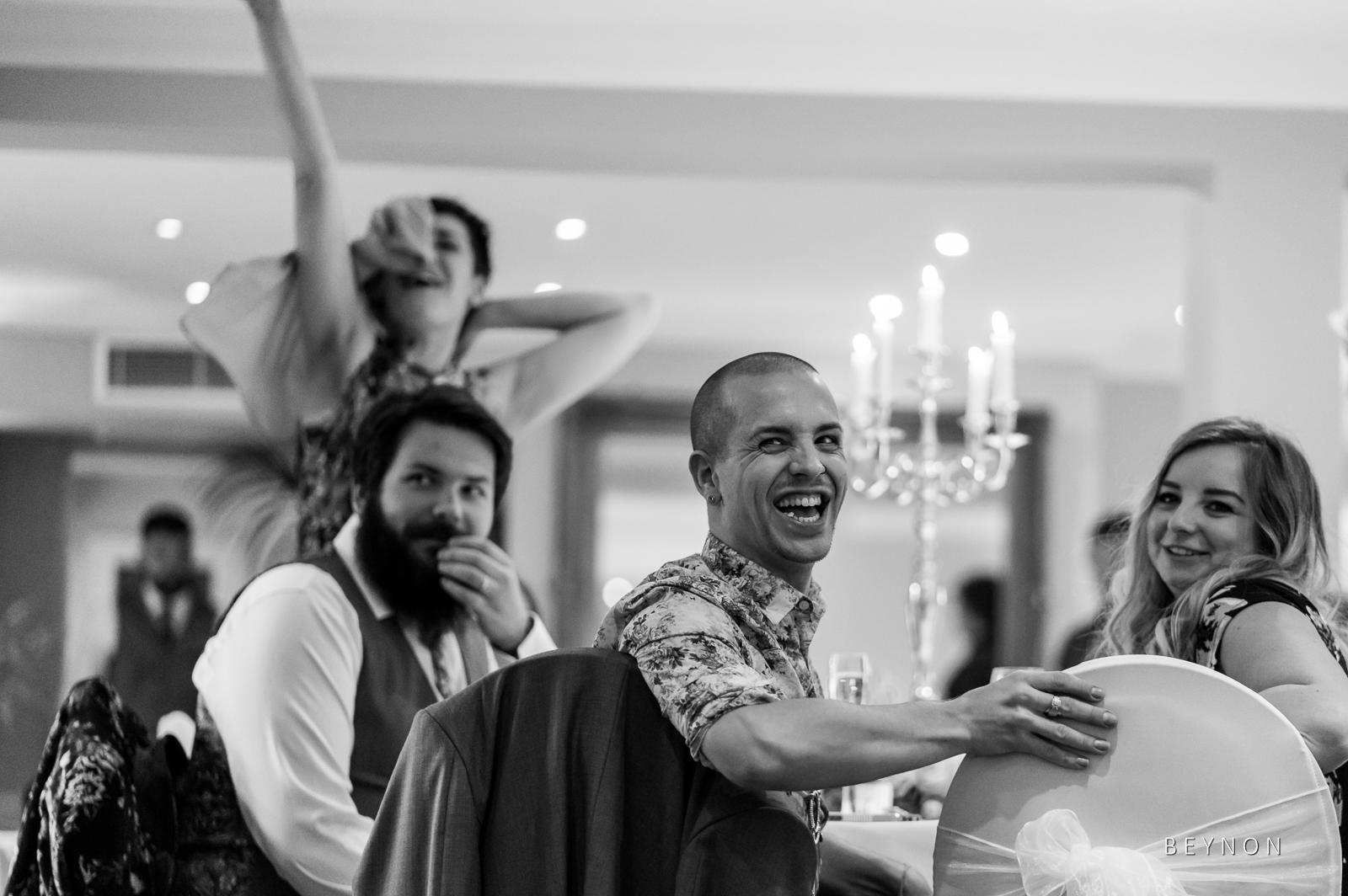 Guests laugh at Best Man's speech
