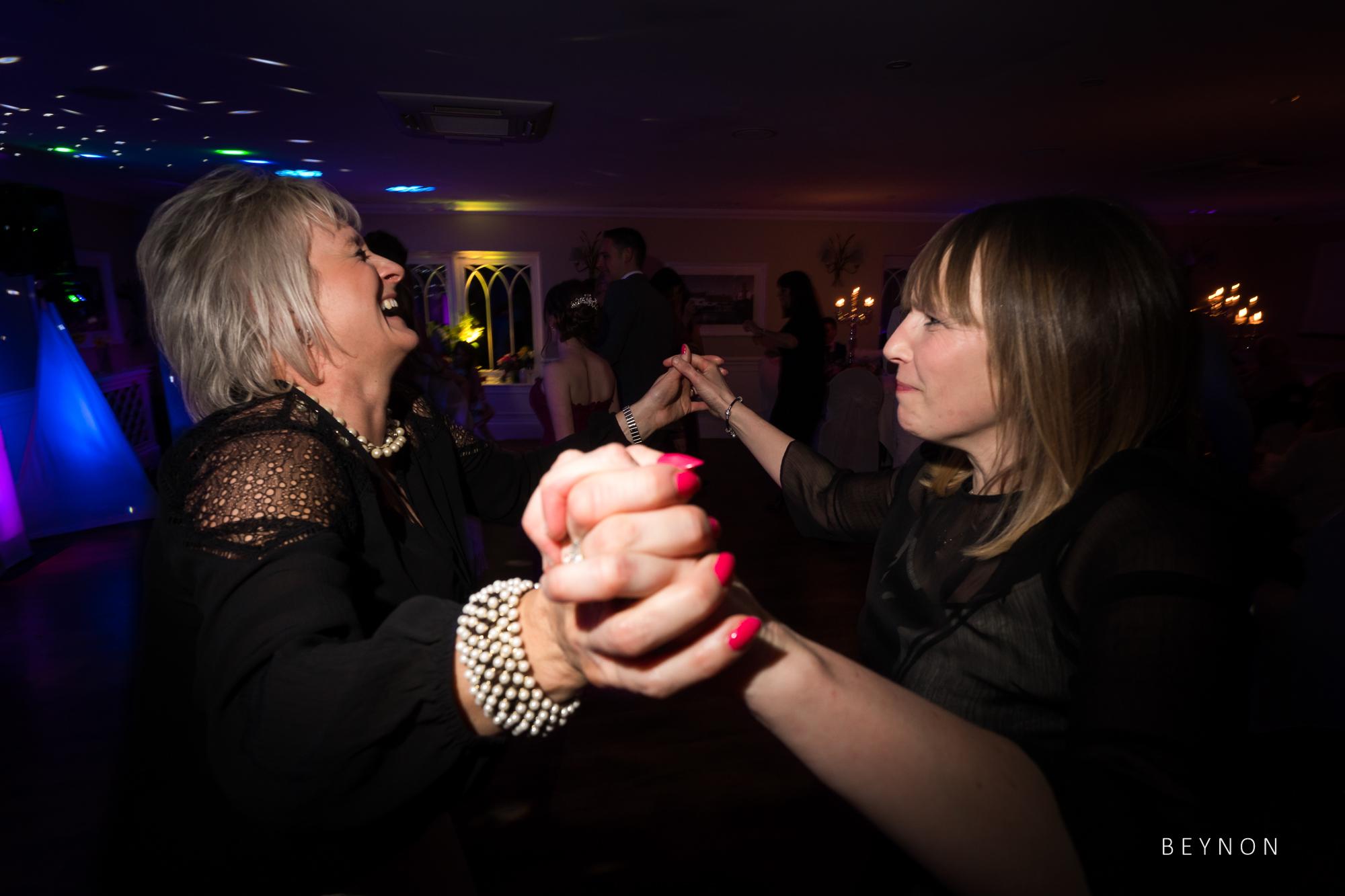 Guests dance hand in hand