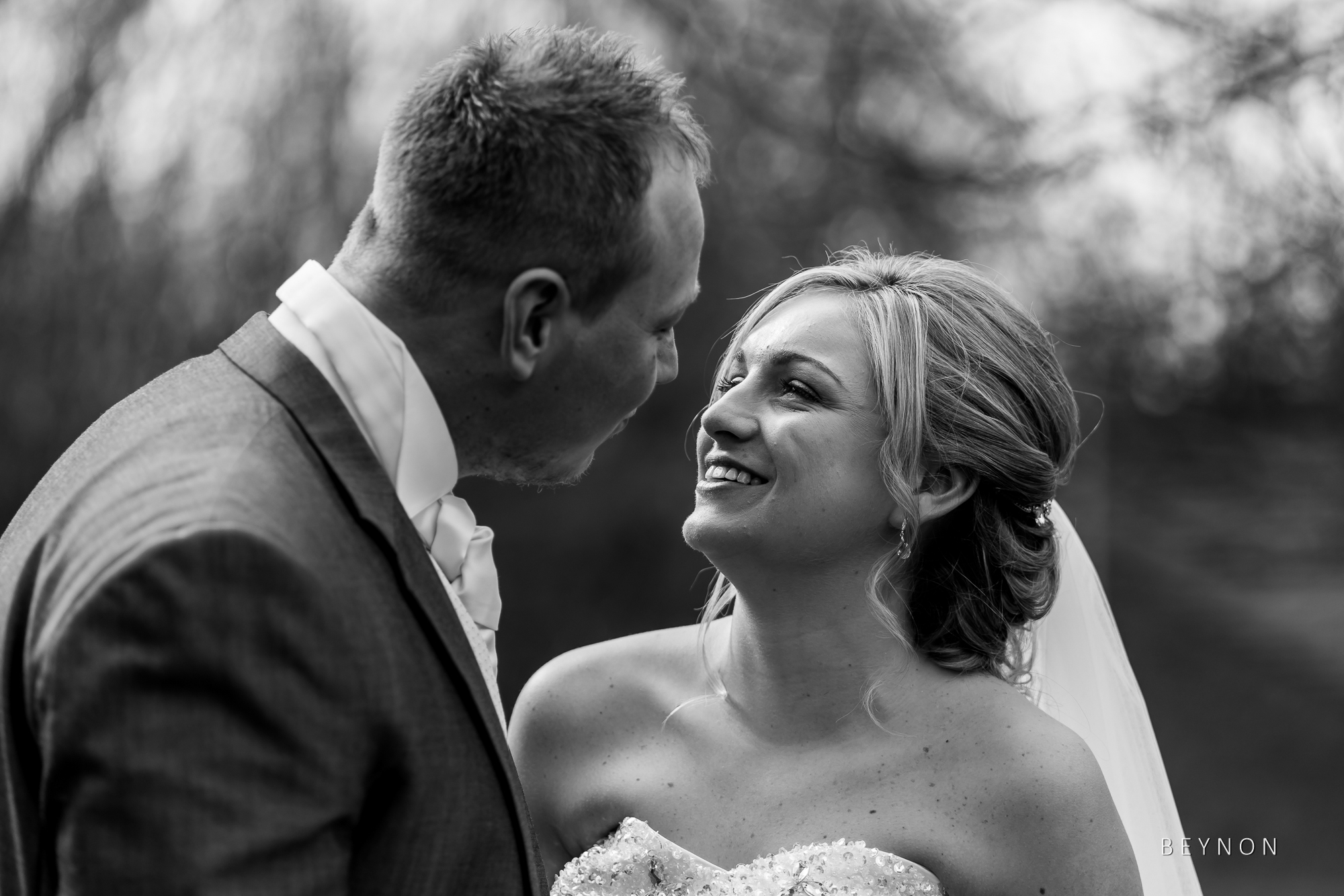 Bride and Groom smile with each other