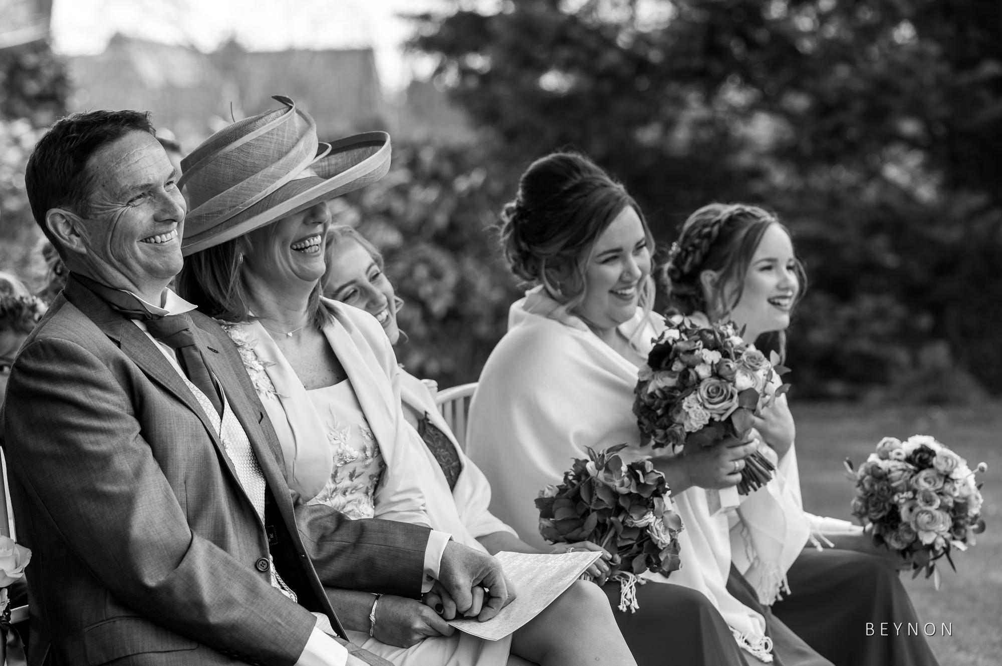 Bridesmaid watch the ceremony