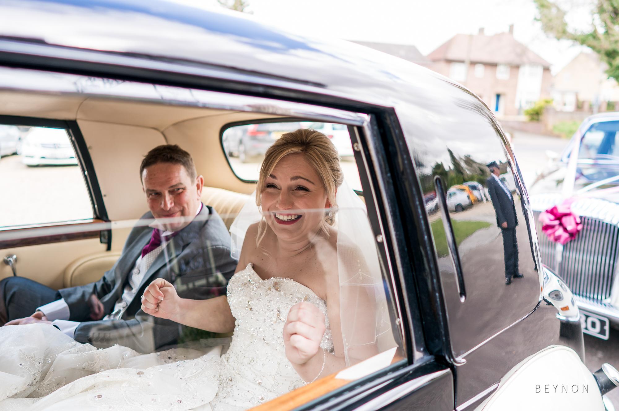 Smiling Bride in wedding car