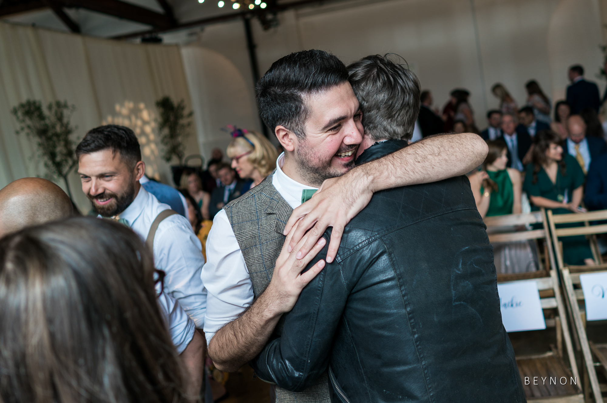 The Groom hugs a guest