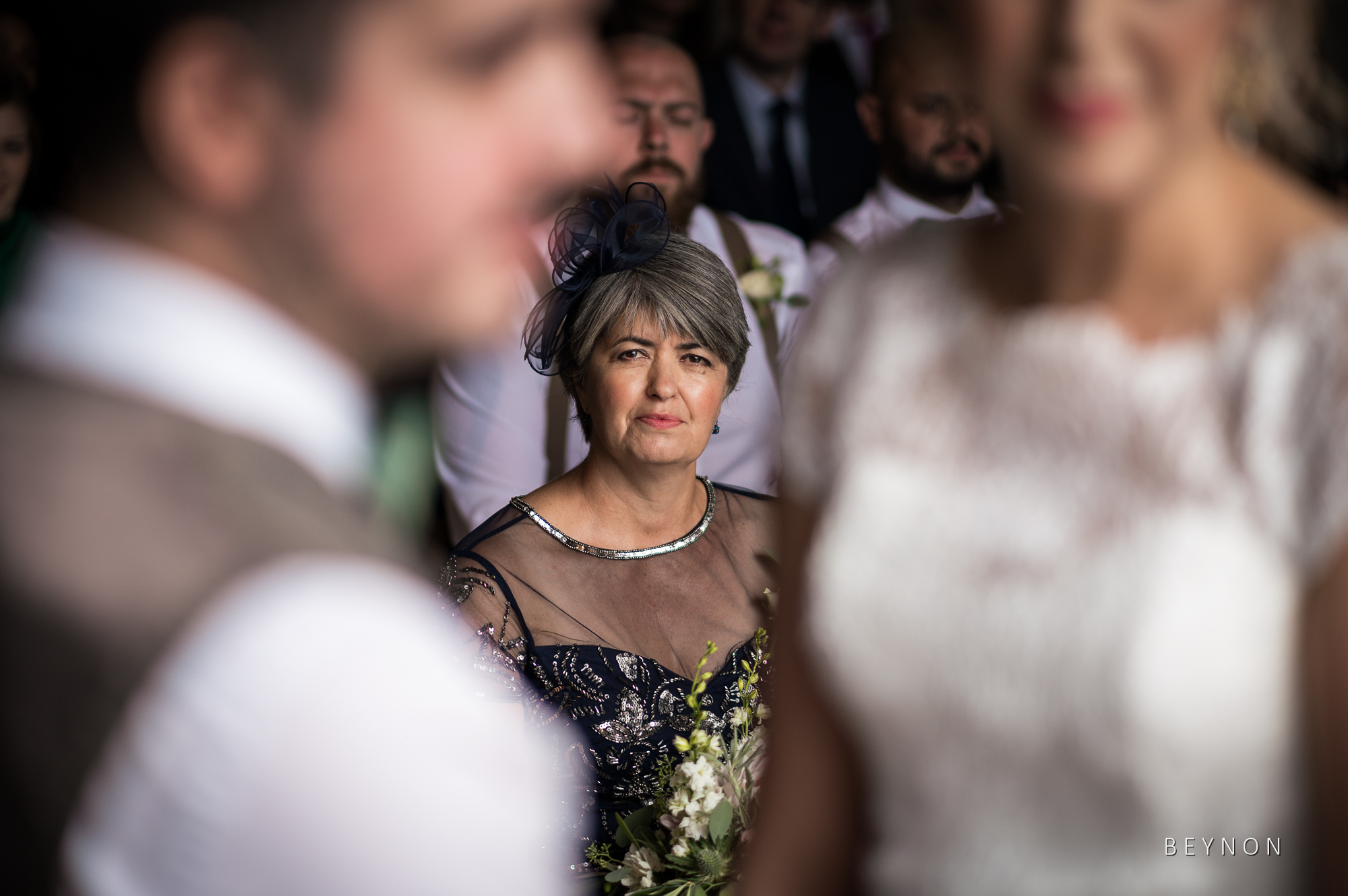 The bride's mother looks on