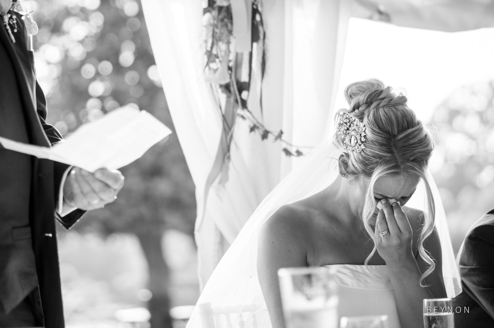 Brides wipes away a tear