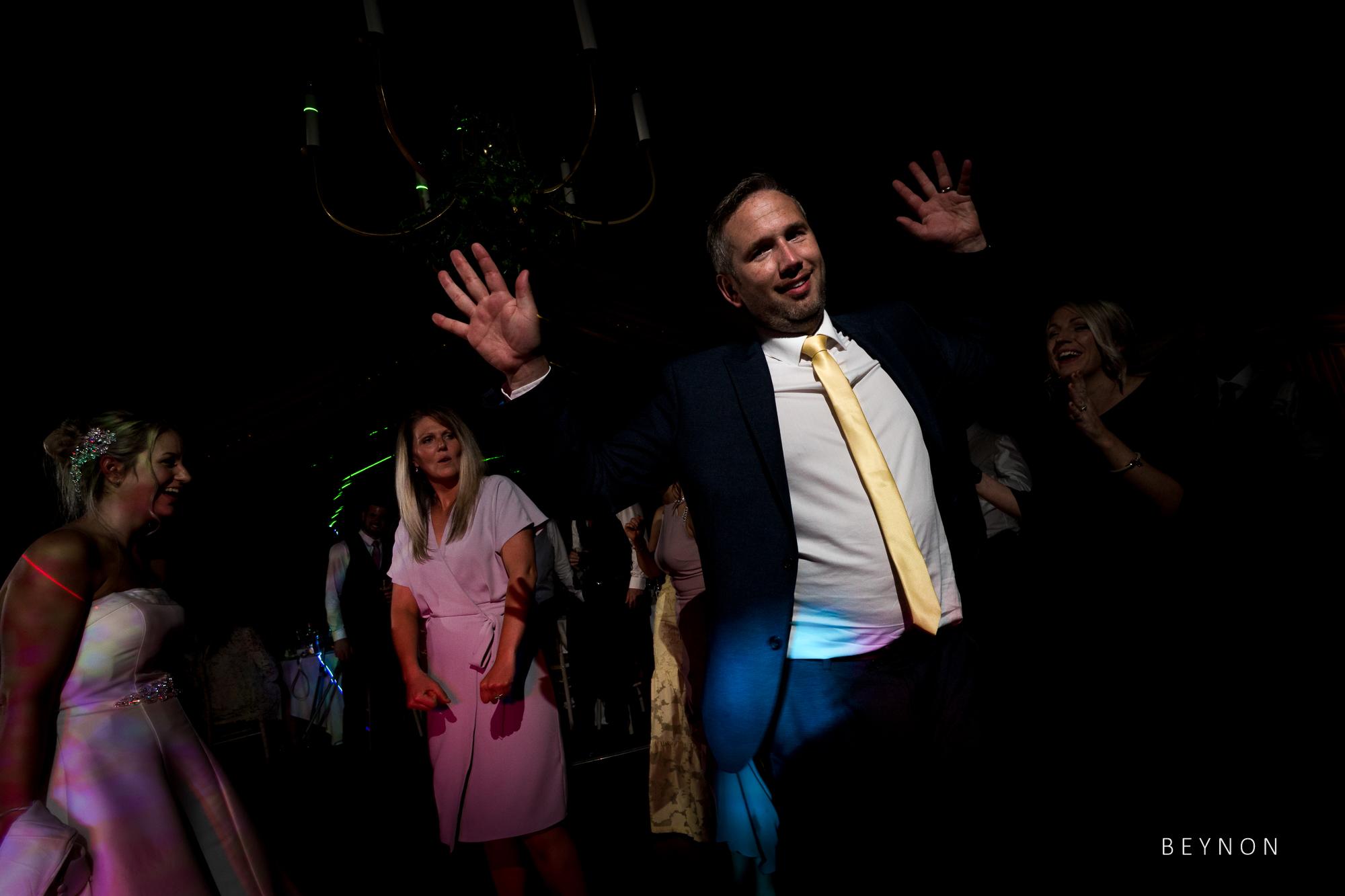 Enthusiastic dancing at wedding reception