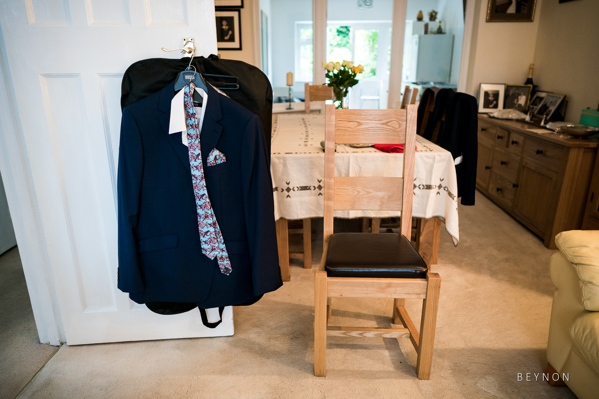 Chair and suit await the groom