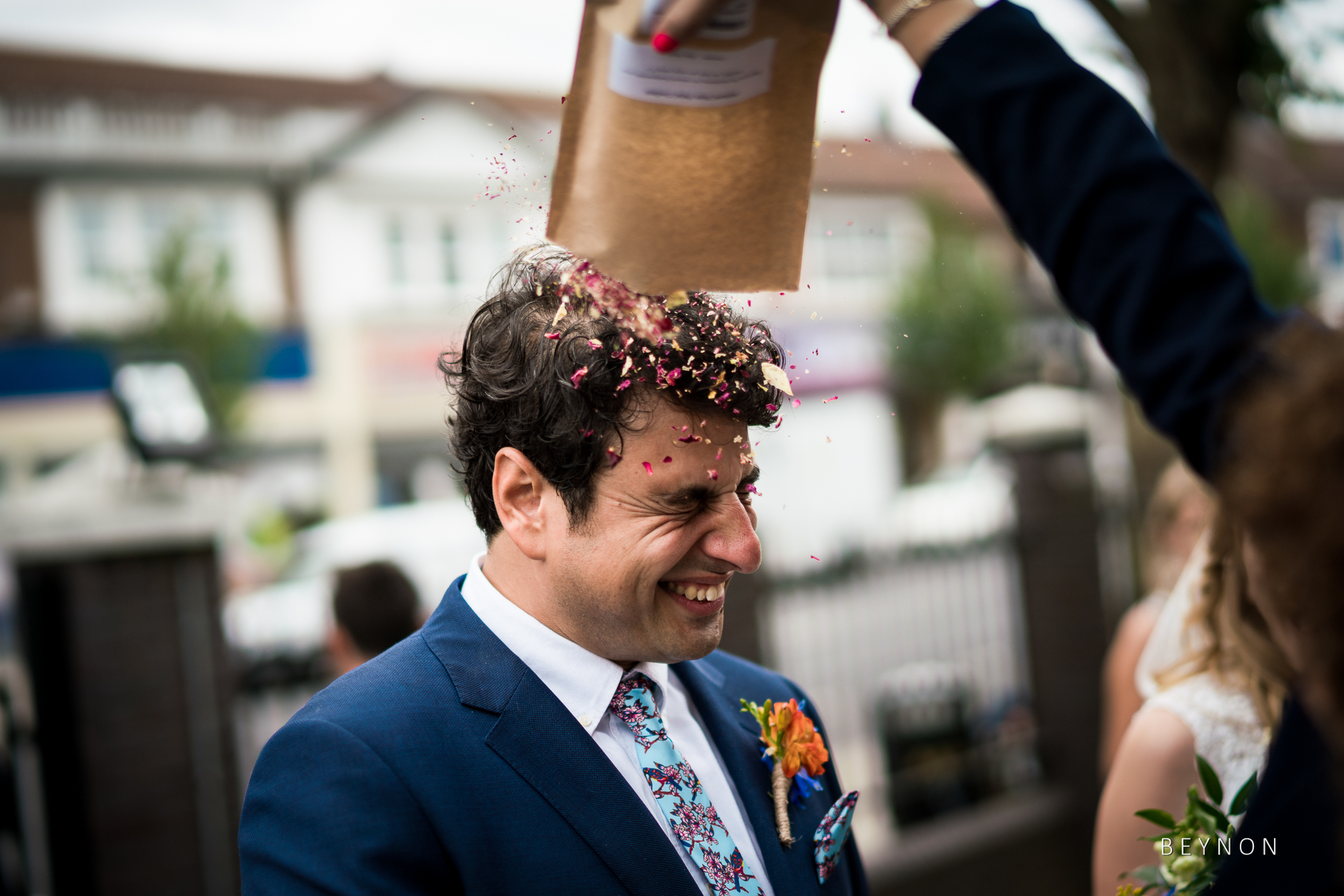 Groom has extra confetti emptied on his head