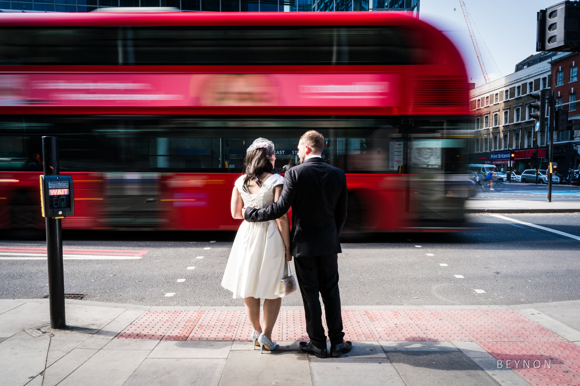Bride and Groom wait to cross the road
