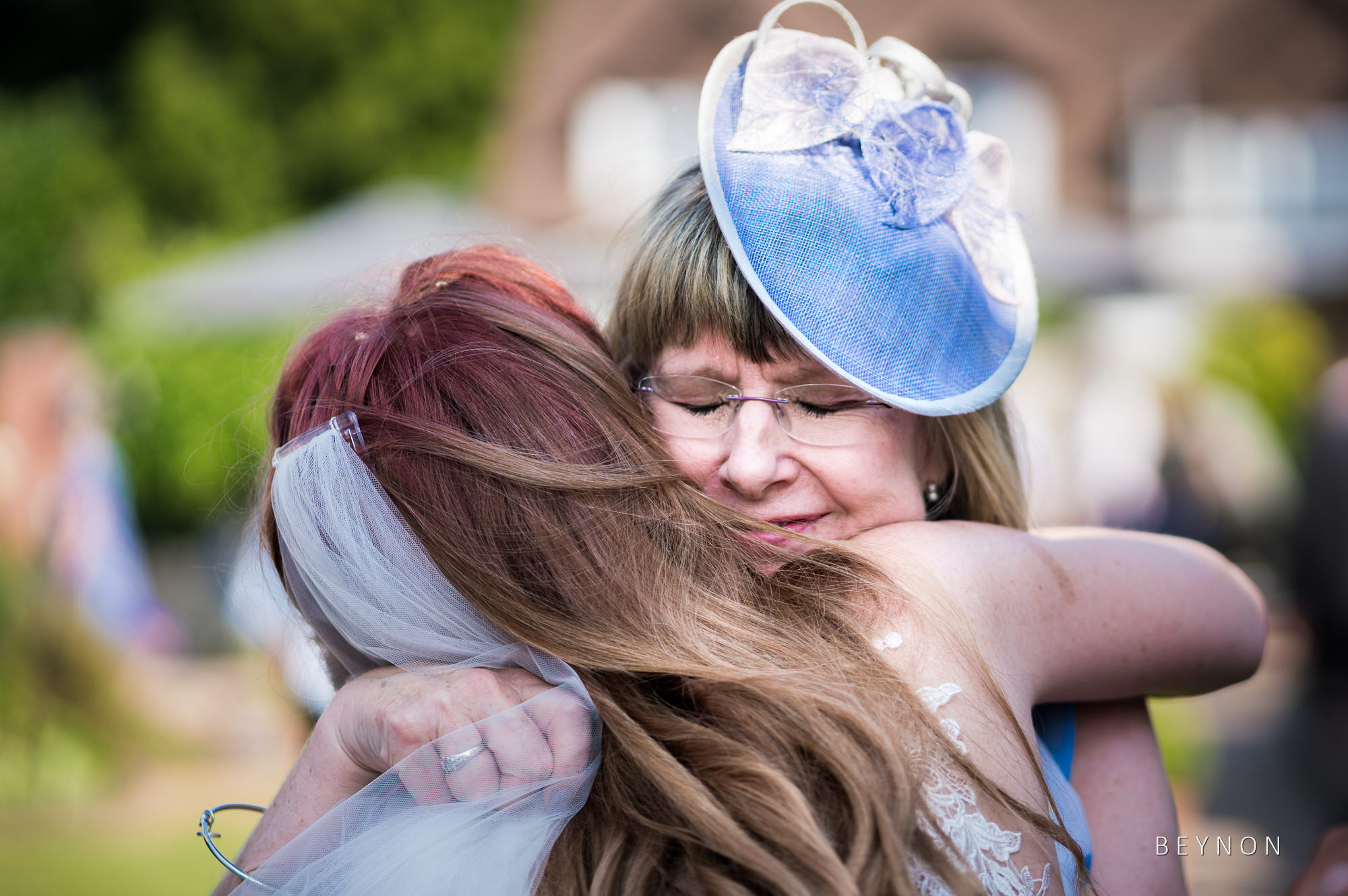 Mother of the bride hugs her daughter
