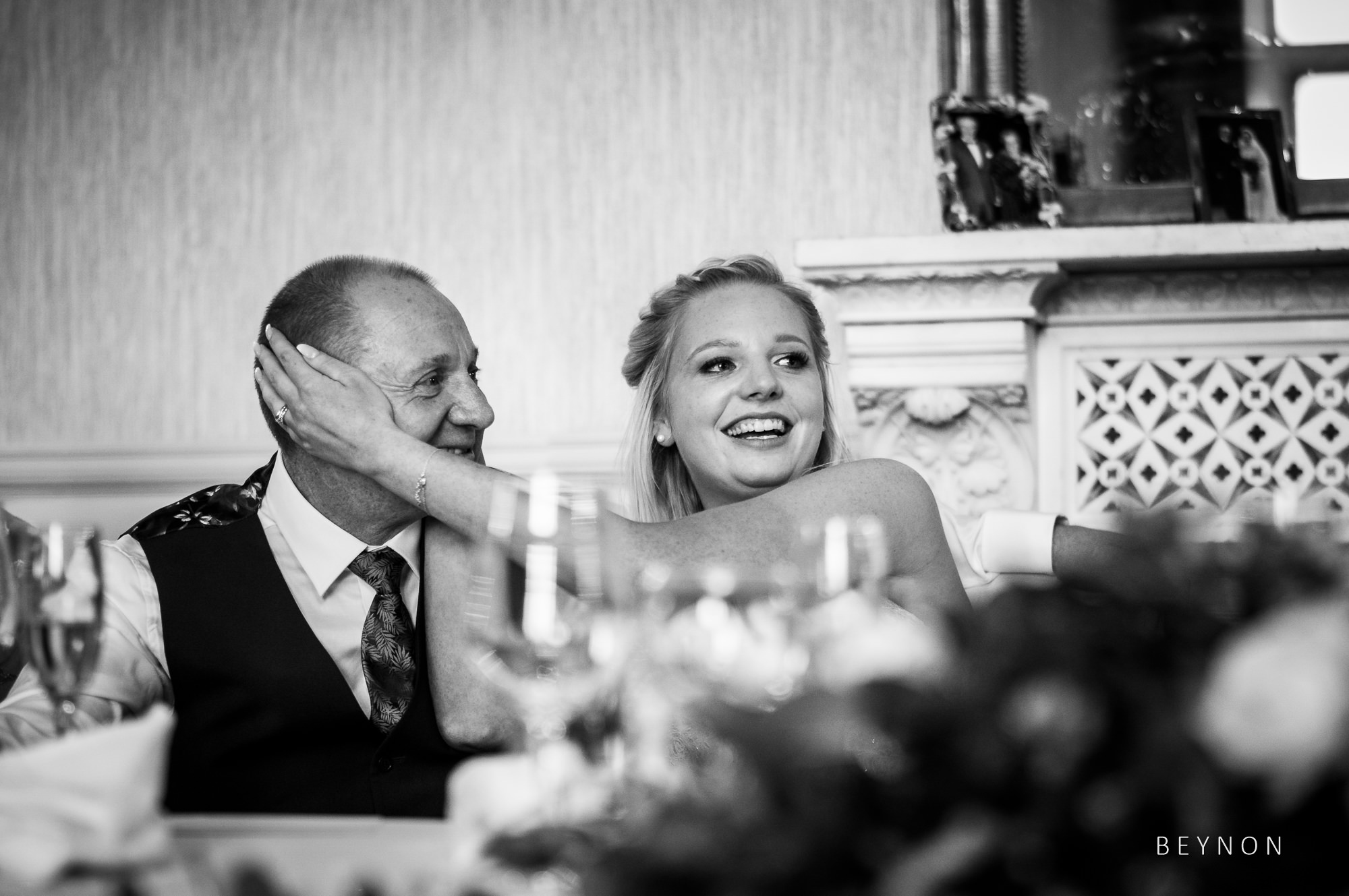 Bride covers her dad's ears during speech
