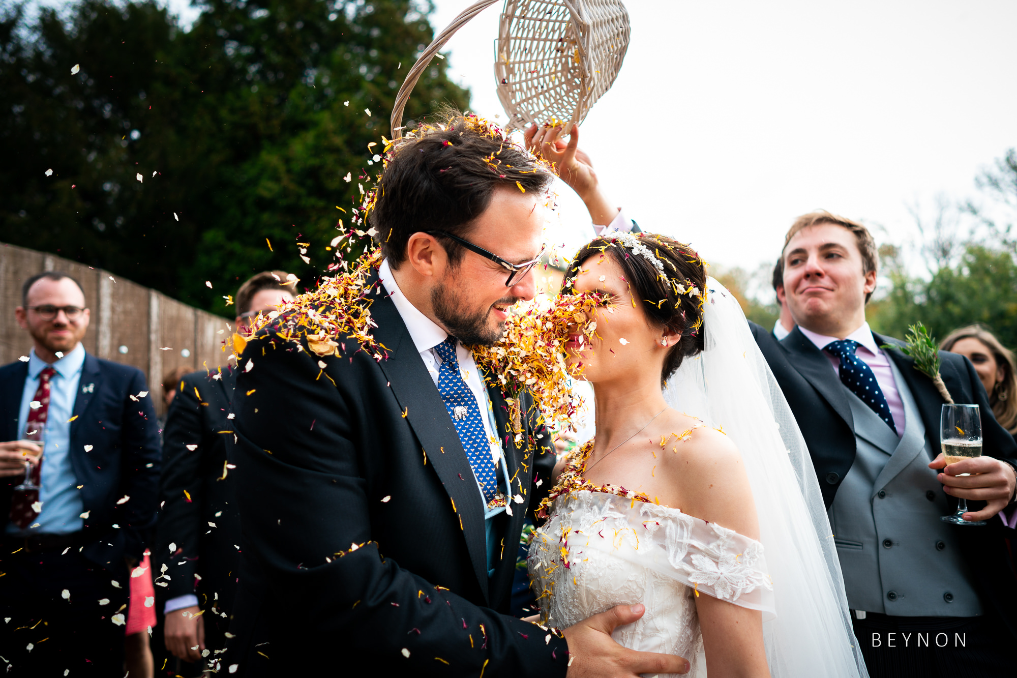 Best Man dumps confetti over the happy couple
