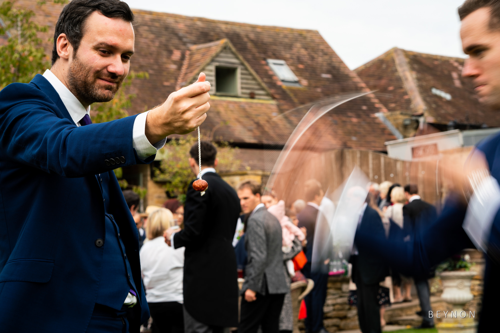 Wedding guests play conkers